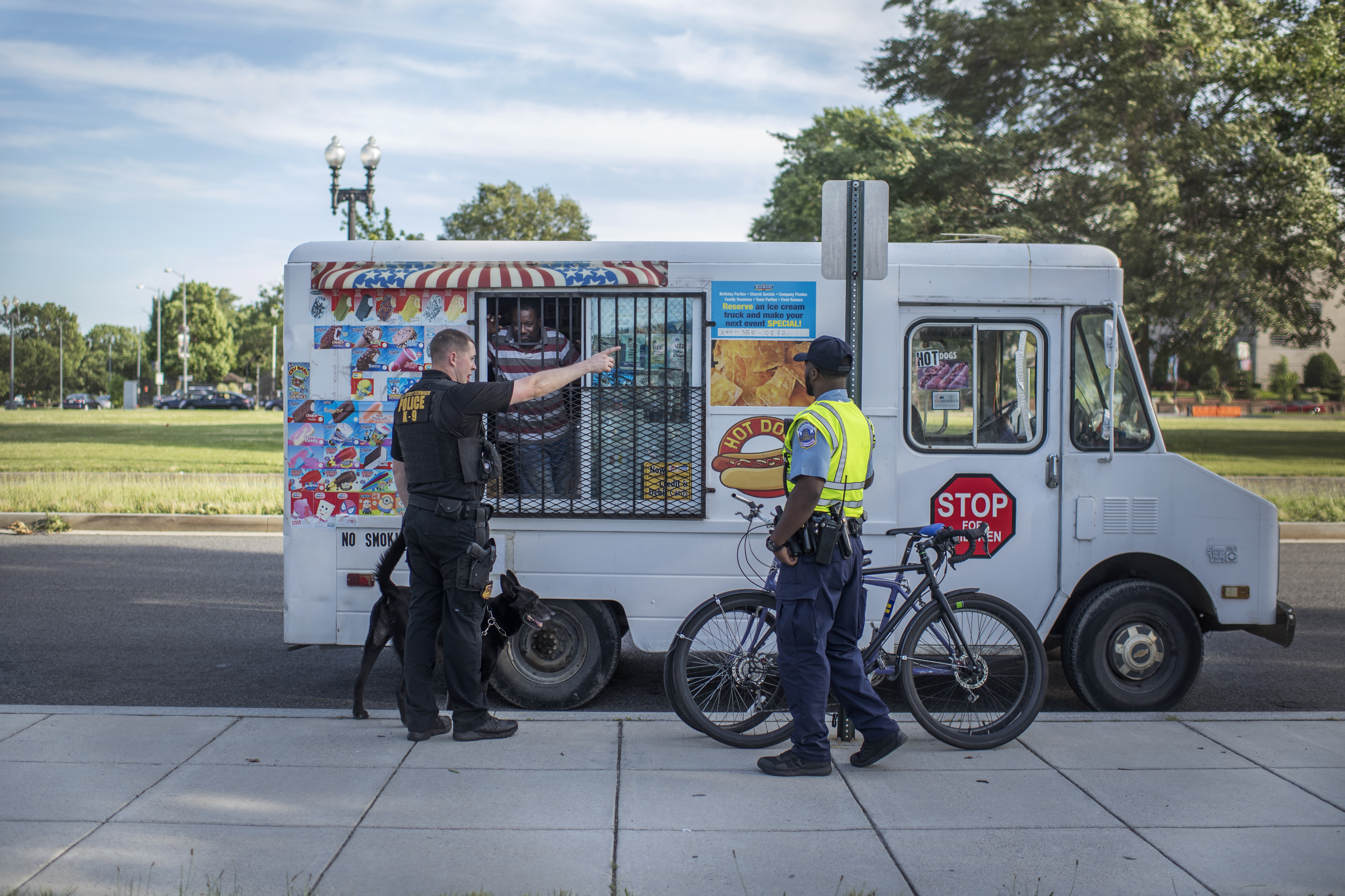 Police direct an ice cream truck to move during a rally for Democratic presidential candidate Sen. Bernie Sanders, I-Vt., outside of RFK Stadium in Washington, DC, June 9. (Photo By Tom Williams/CQ Roll Call)