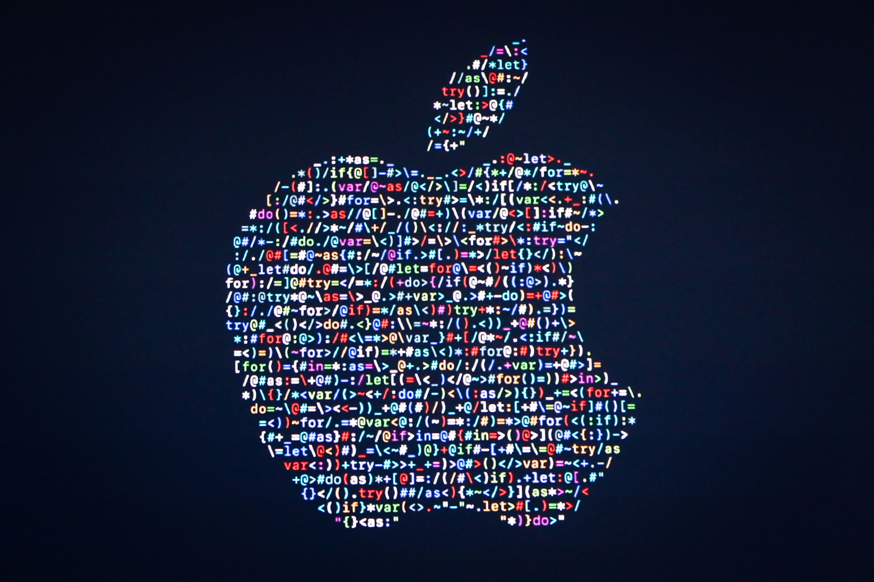 The Apple logo is displayed on a screen at Apple's annual Worldwide Developers Conference presentation at the Bill Graham Civic Auditorium in San Francisco on June 13.