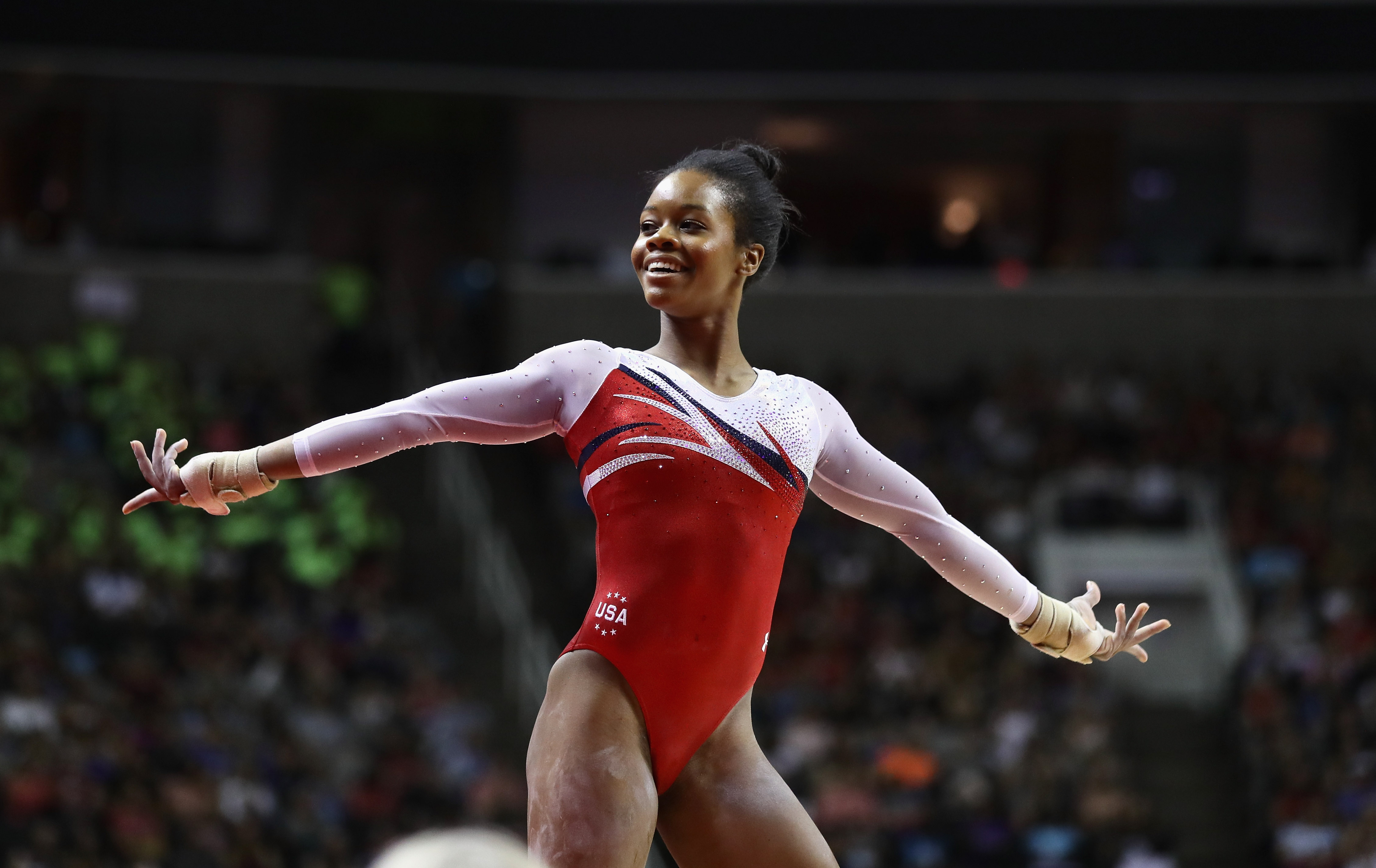 Gabrielle Douglas competes in the floor exercise during Day 2 of the 2016 U.S. Women's Gymnastics Olympic Trials at SAP Center on July 10 in San Jose, California.  (Photo by Ezra Shaw/Getty Images)