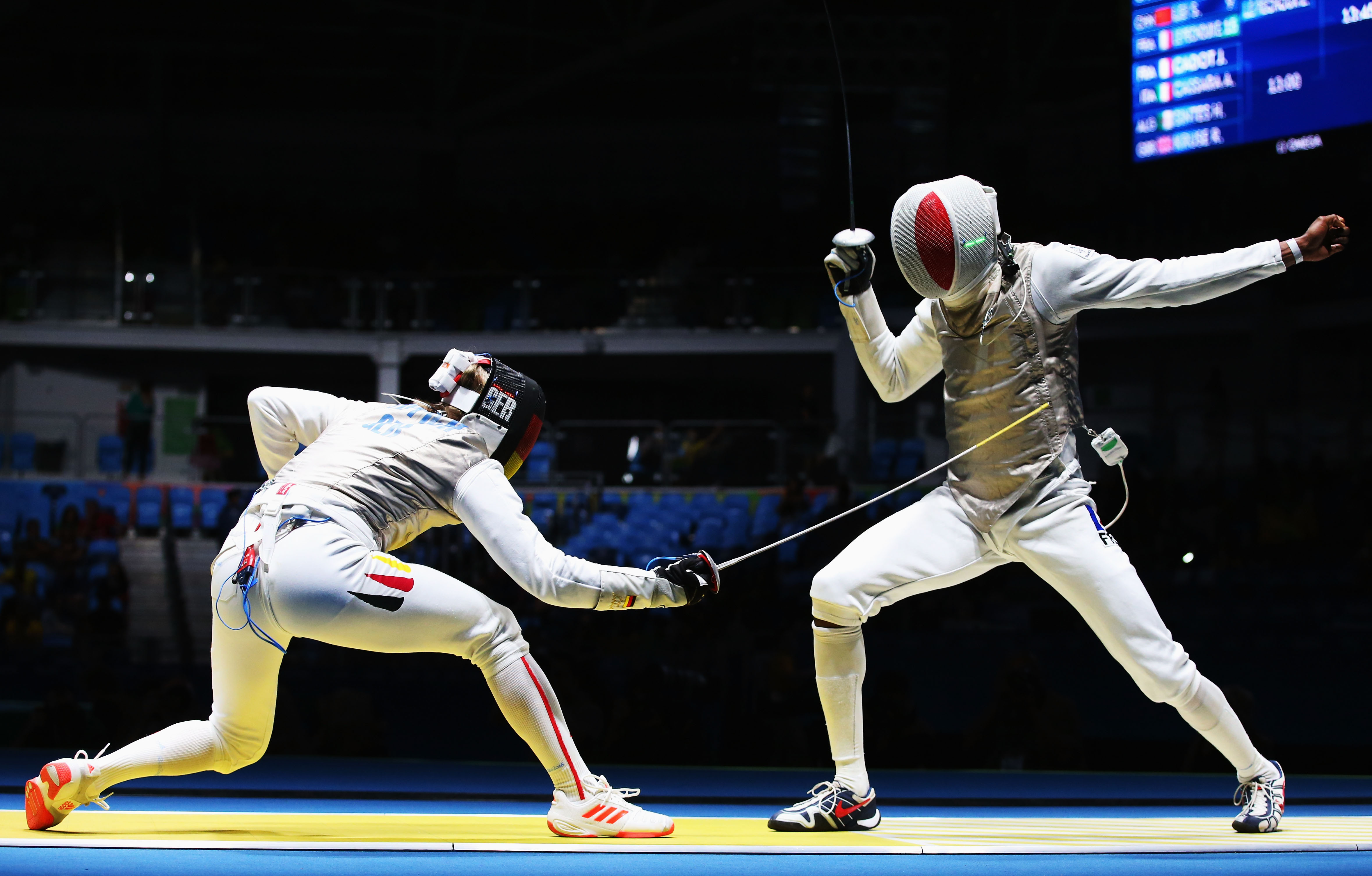 RIO DE JANEIRO, BRAZIL - AUGUST 07: Peter Joppich (L) of Germany competes on his way to defeating Enzo Lefort of France during Men's Individual Foil on Day 2 of the Rio 2016 Olympic Games at Carioca Arena 3 on August 7, 2016 in Rio de Janeiro, Brazil.  (Photo by Alex Livesey/Getty Images)