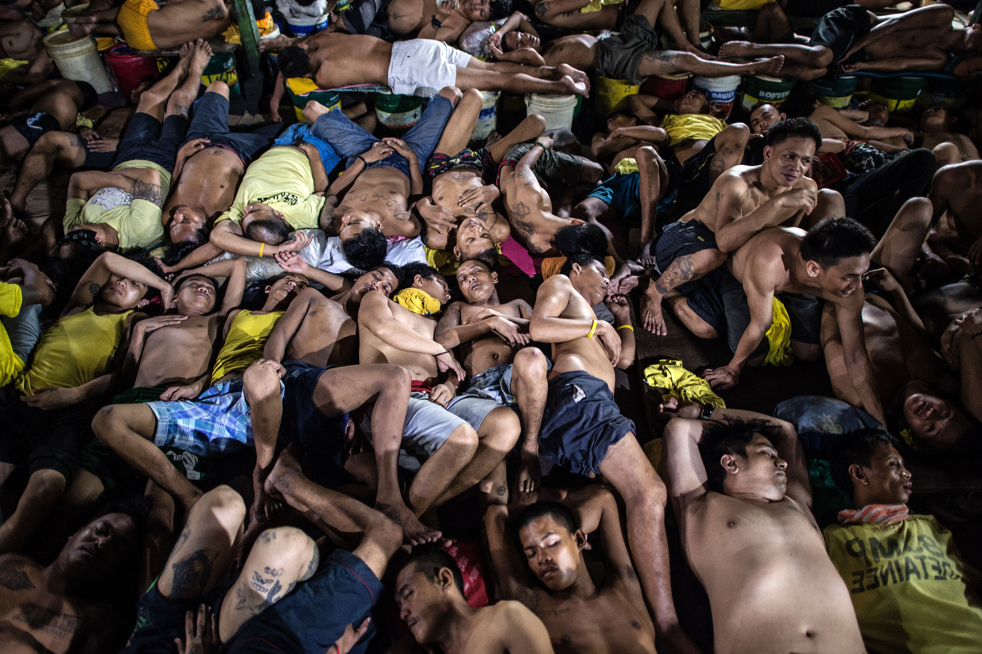 This picture taken on July 21, 2016, shows inmates sleeping inside the Quezon City jail in Manila. Philippine officials said on Aug. 9, 2016, the government would build new jails to address severe congestion made worse by President Rodrigo Duterte's drug war, describing conditions as  inhumane  and  unacceptable