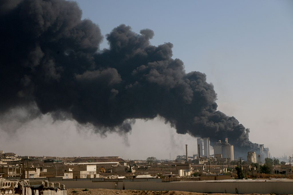 Smoke rises after Russian forces airstrike over opposition controlled cement plant located in southeast of Aleppo, Syria on August 09, 2016.