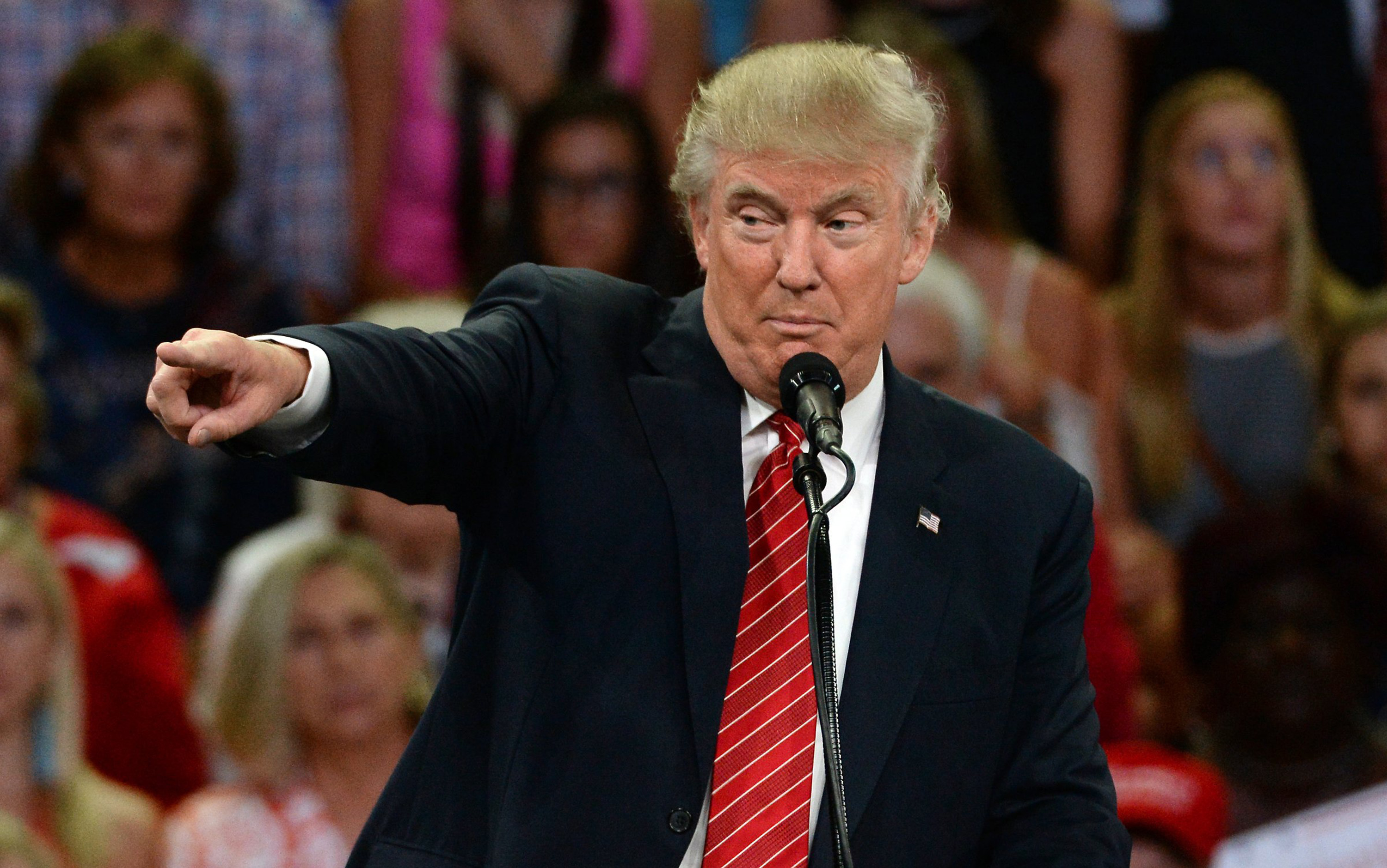 Republican presidential candidate Donald Trump points to a member of the audience as he makes remarks Aug. 9, 2016 in Wilmington, N.C.