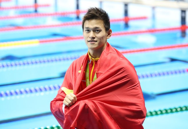 Sun Yang of China celebrates winning the gold medal in the men's 200-m freestyle on day 3 of the Olympic Games on Aug. 8, 2016, in Rio de Janeiro