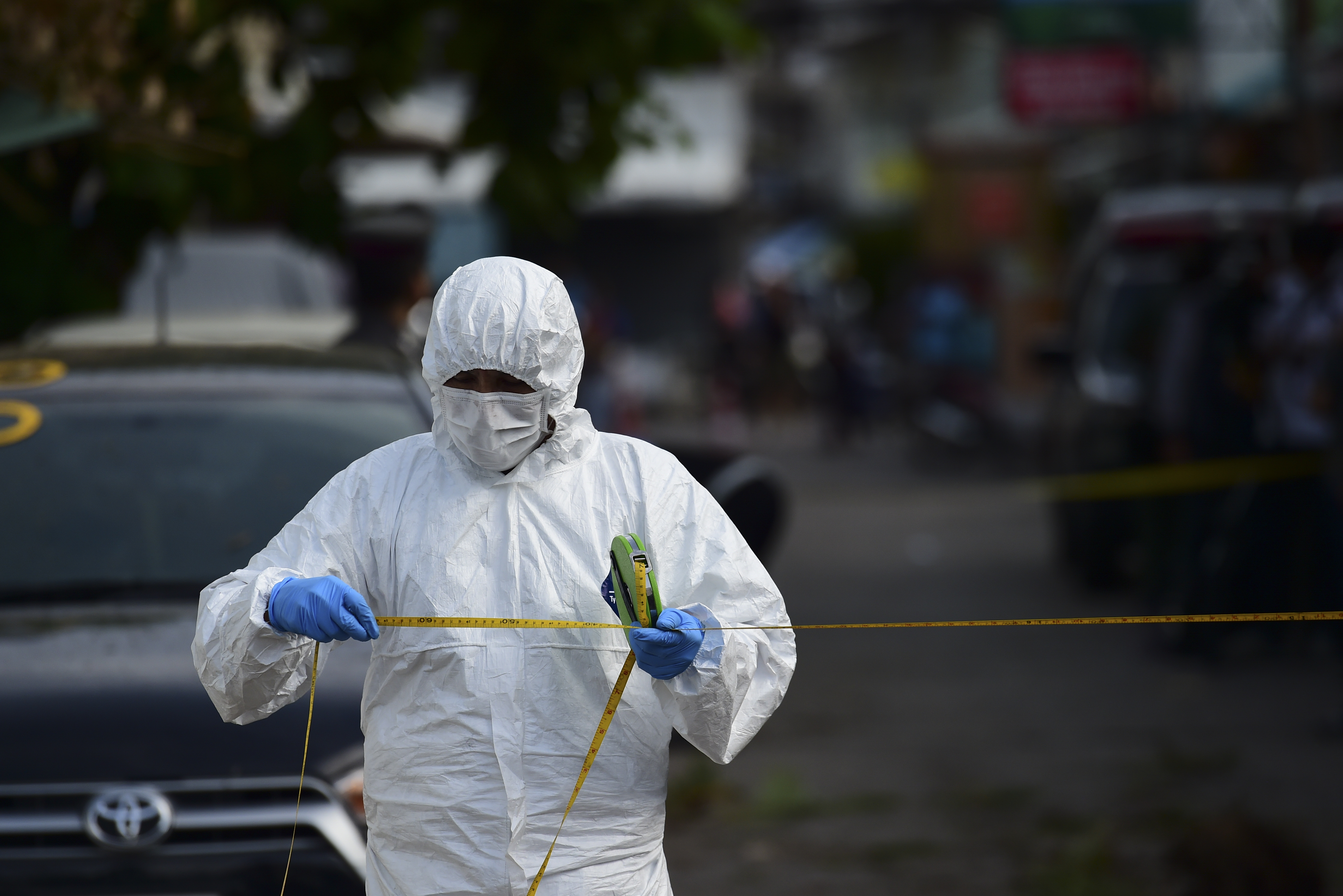 An investigation official collects evidence from the crime scene after a small bomb exploded in Hua Hin, Thailand, on Aug. 12, 2016