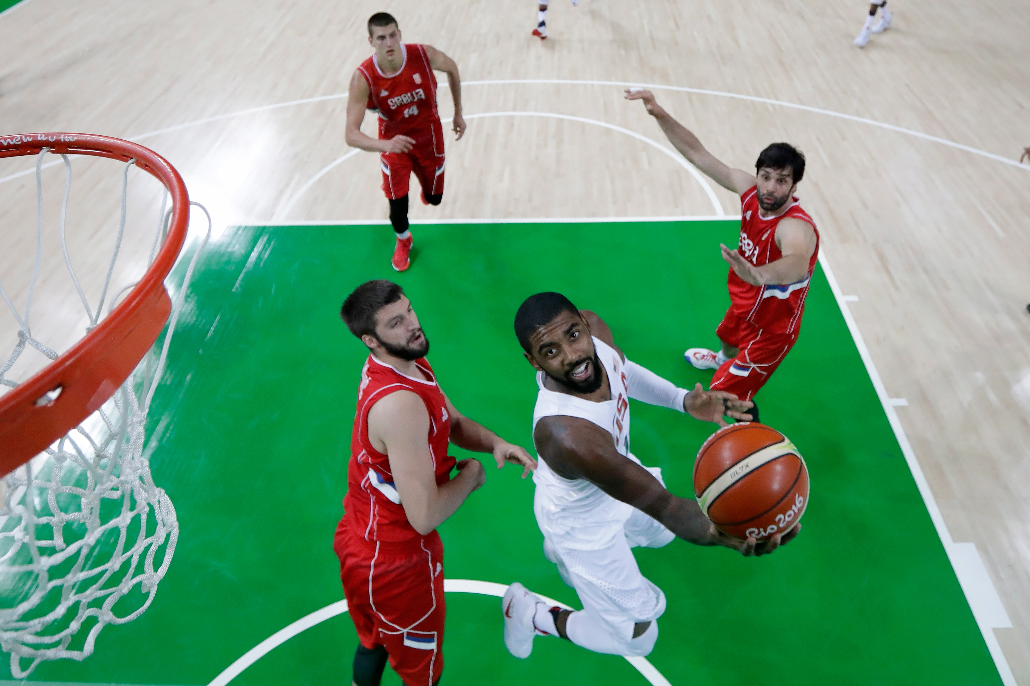 Kyrie Irving of United States goes to the basket against Stefan Markovic of Serbia at the Rio 2016 Olympic Games at Carioca Arena 1 on August 12, 2016 in Rio de Janeiro, Brazil.