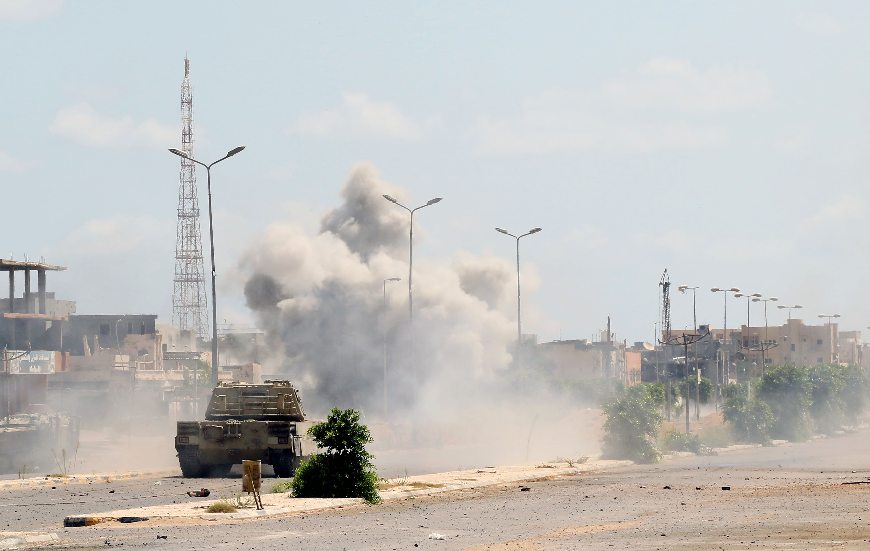 Forces loyal to Libya's UN-backed Government of National Accord (GNA) drive their military vehicle in al-Zaafaran neighbourhood as they fight Islamic State group (IS) jihadists holed up in residential district two on August 14, 2016 in Sirte, east of the capital Tripoli.