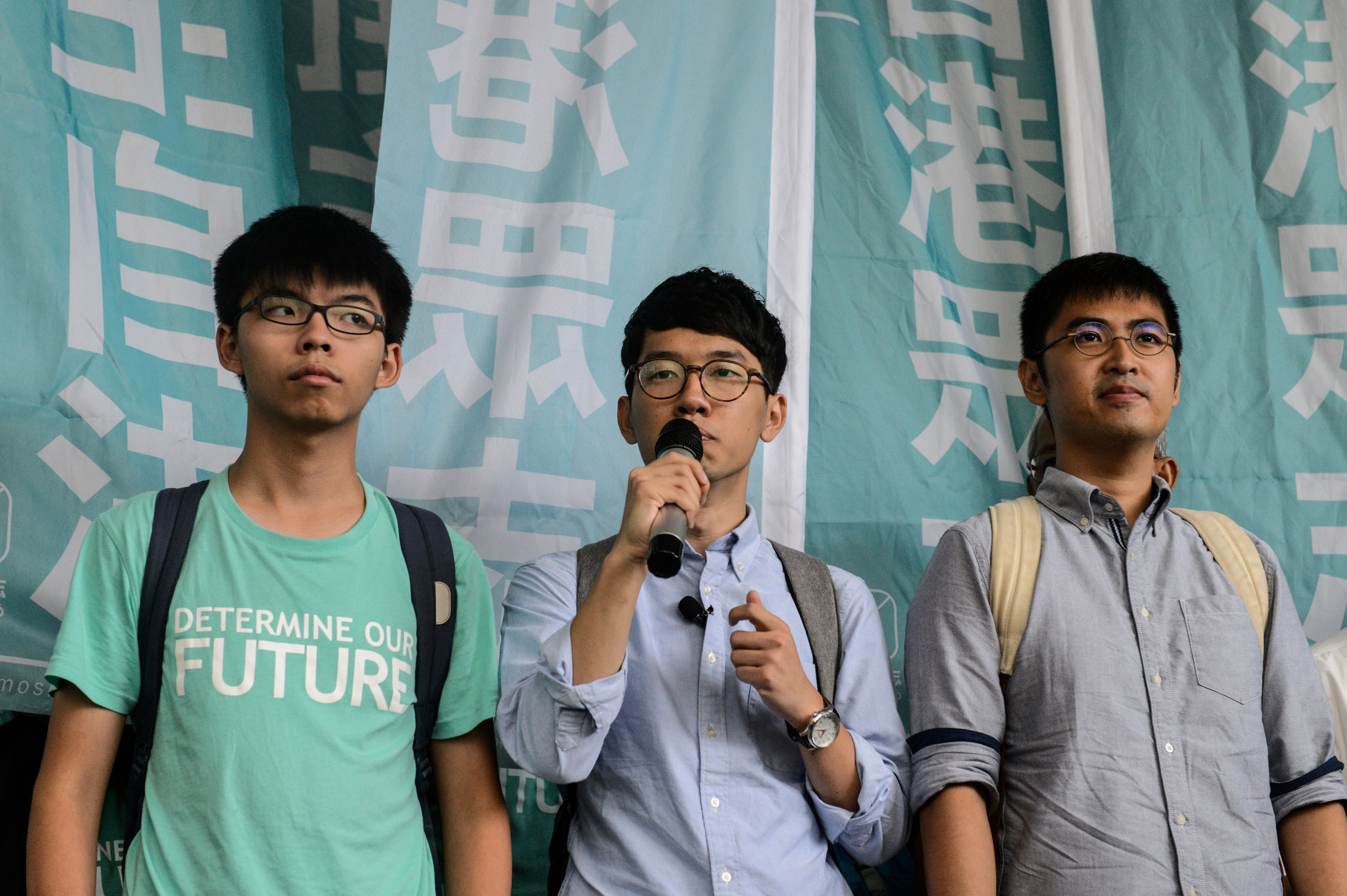 Leaders of Hong Kong's Umbrella Revolution, left to right, Joshua Wong, 19; Nathan Law, 23; and Alex Chow, 25, speak to the press following their sentencing at the Eastern Court in Hong Kong on Aug. 15, 2016