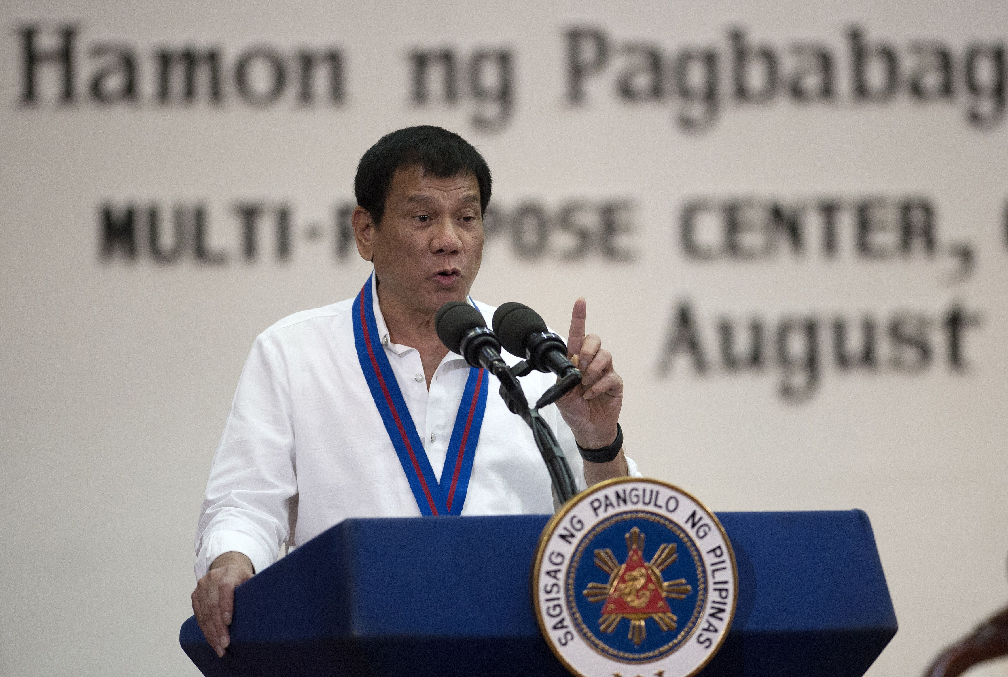 Philippine President Rodrigo Duterte gestures as he talks during the 115th police-service anniversary at the Philippine National Police headquarters in Manila on Aug. 17, 2016