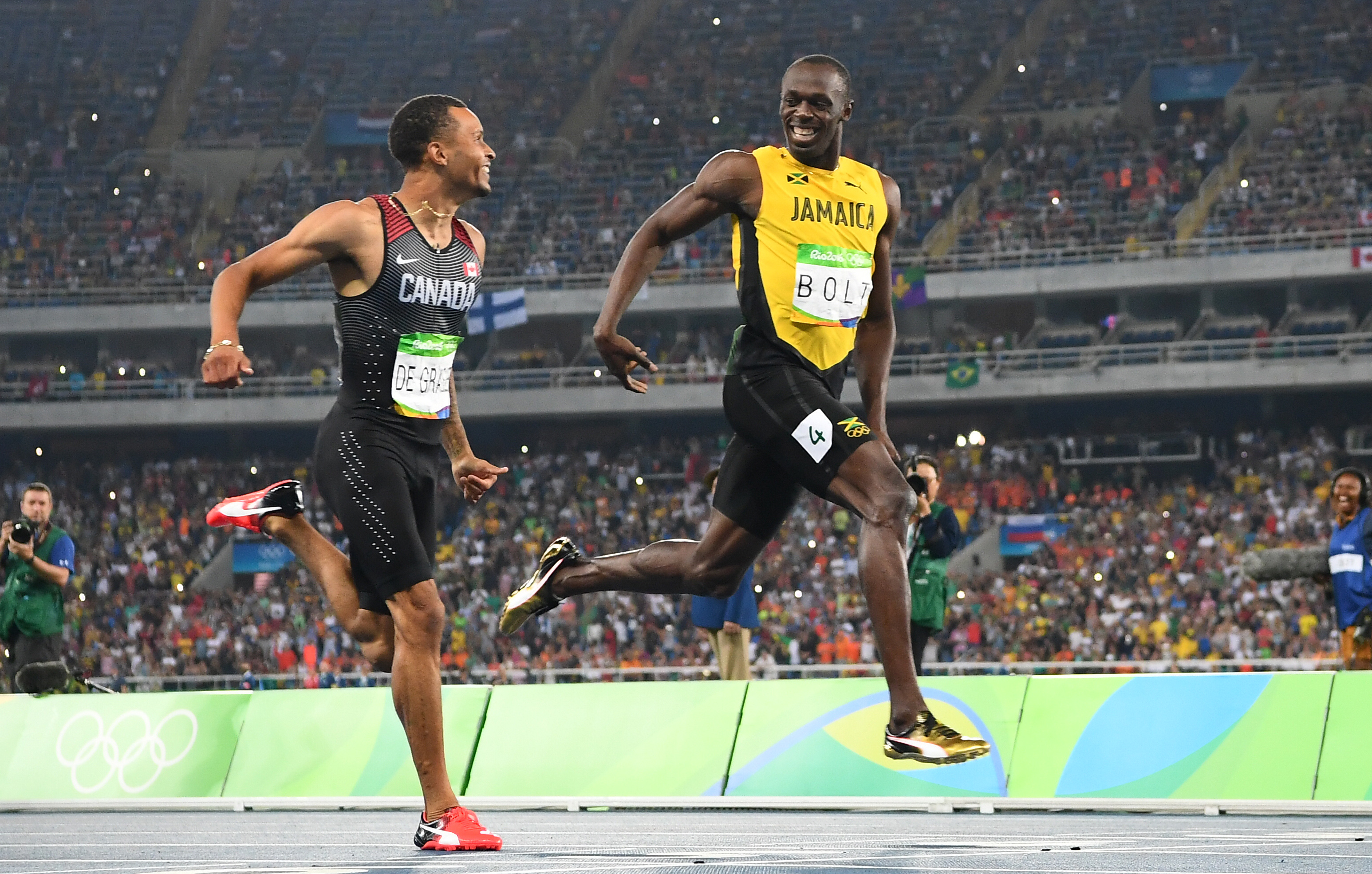 Canada's Andre De Grasse and Jamaica's Usain Bolt compete in the Men's 200m Semifinal at the Rio 2016 Olympic Games on Aug. 17, 2016.