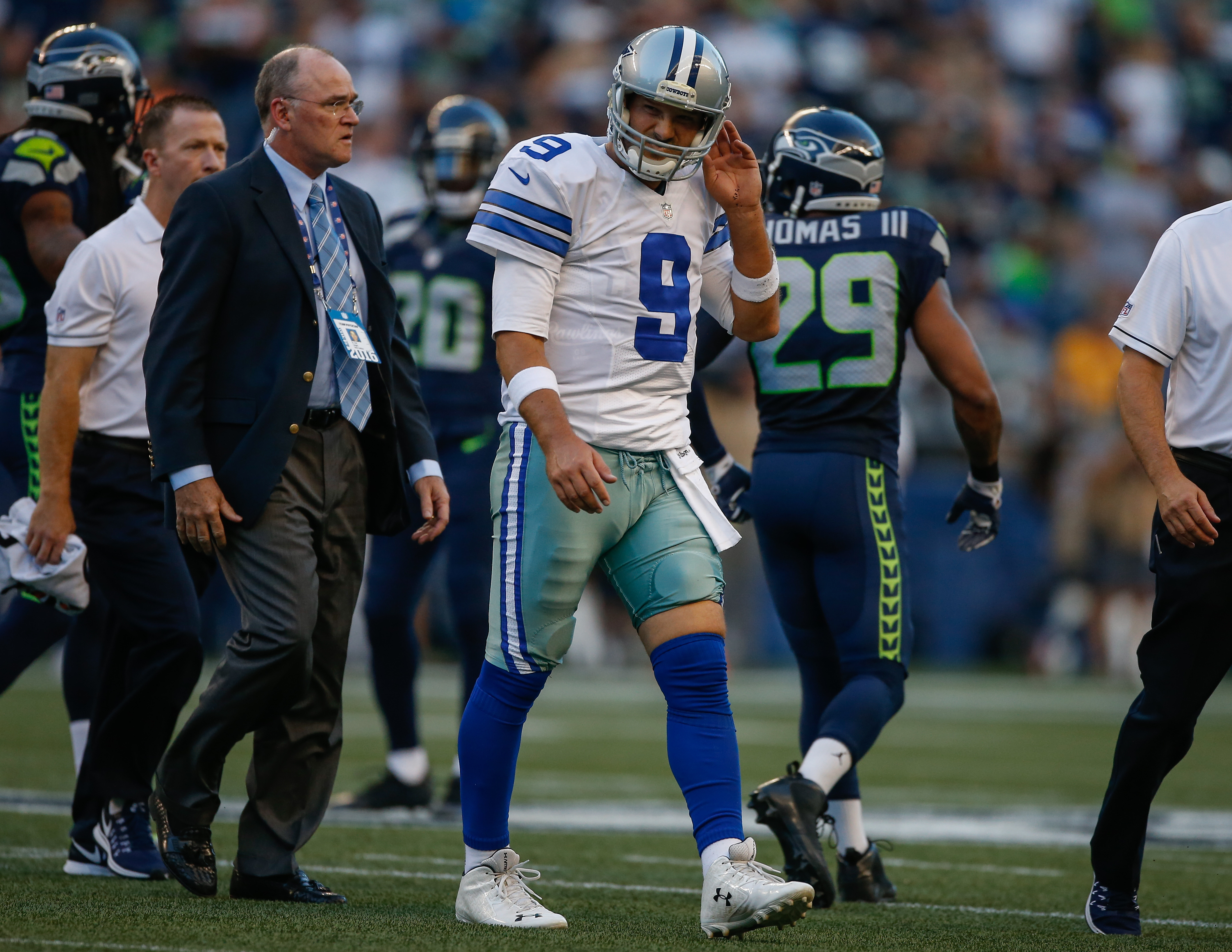 Quarterback Tony Romo of the Dallas Cowboys leaves the field after being injured during a preseason game against the Seattle Seahawks in Seattle, Washington, on Aug. 25, 2016.