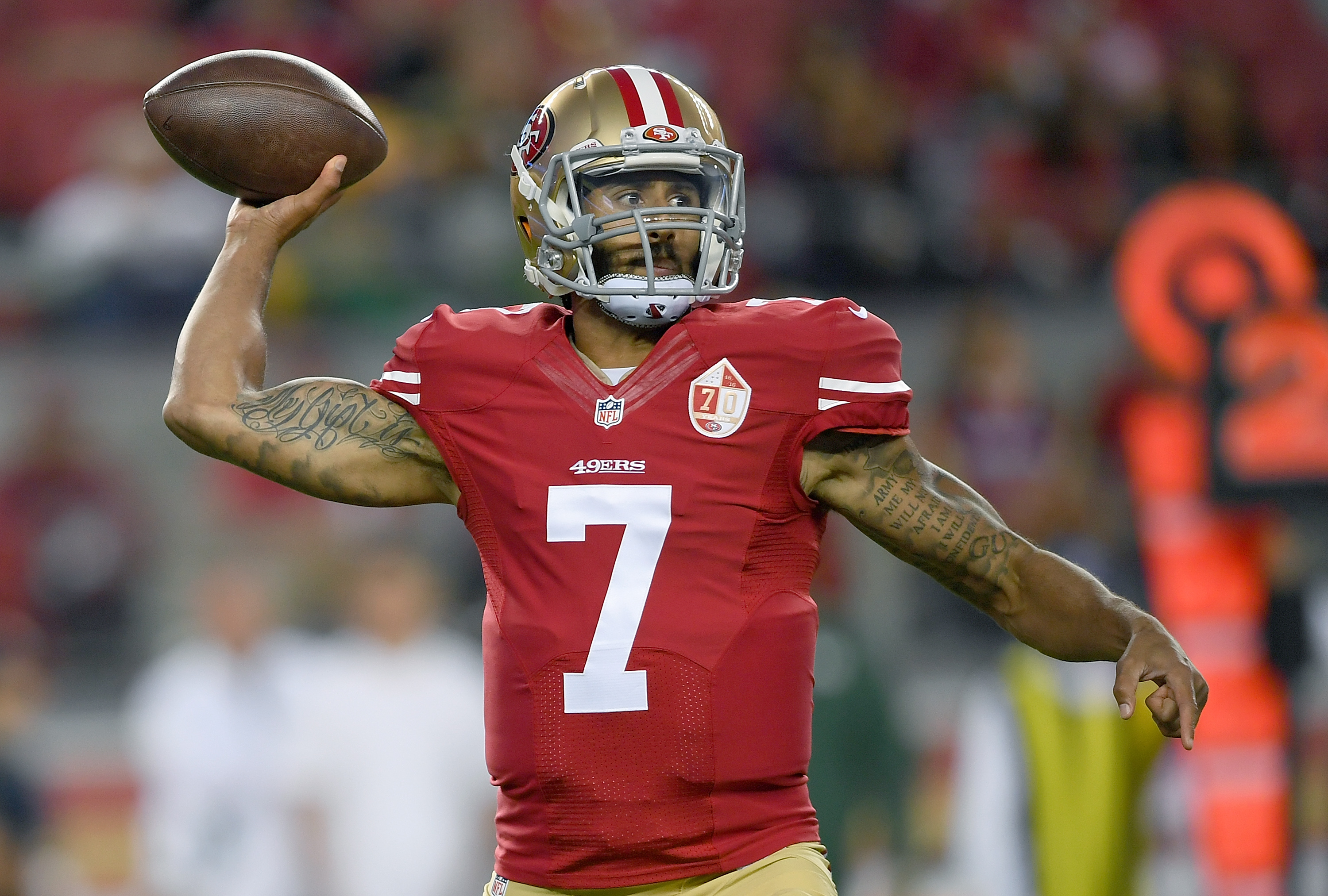 Quarterback Colin Kaepernick #7 of the San Francisco 49ers throws a pass against the Green Bay Packers in the first half of their preseason football game at Levi's Stadium on August 26, 2016 in Santa Clara, California.Thearon W. Henderson—Getty Images