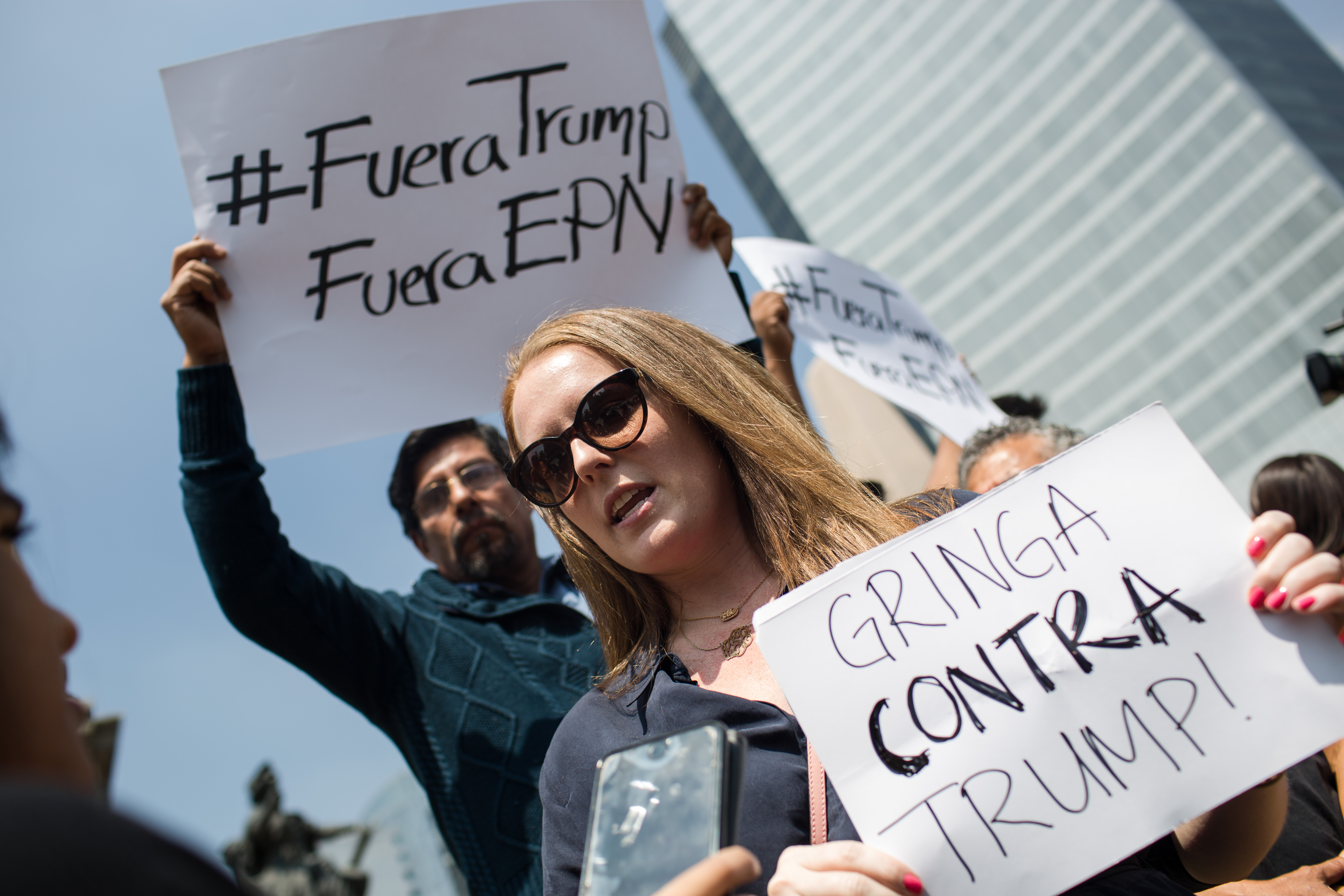 Demonstrators hold signs protesting the visit of Donald Trump, the 2016 U.S. Republican presidential nominee, to Mexico for a meeting with Mexican President Enrique Peña Nieto in Mexico City on Aug. 31, 2016