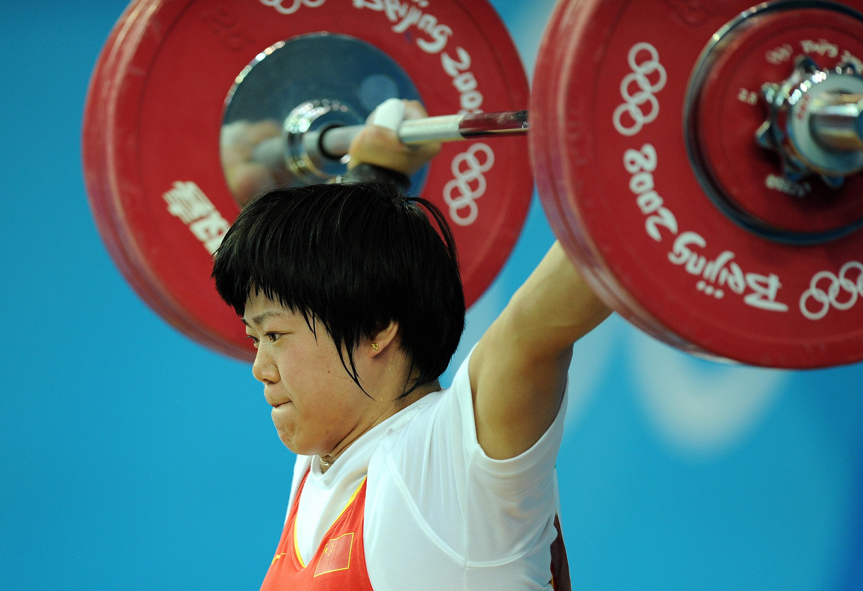 Liu Chunhong of China sets a new world record in the 125-kg snatch of the women's 69-kg weightlifting event at the Olympic Games in Beijing on Aug. 13, 2008