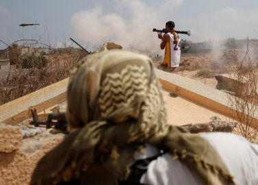 Libyan forces allied with the U.N.-backed unity government fire weapons during a battle against ISIS in Sirt, Libya, on July 15, 2016.