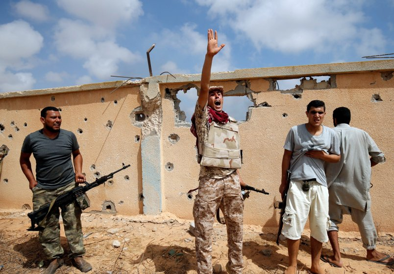 A member of Libyan forces allied with the U.N.-backed unity government gestures during a battle against ISIS in Sirt, Libya, on July 15, 2016.