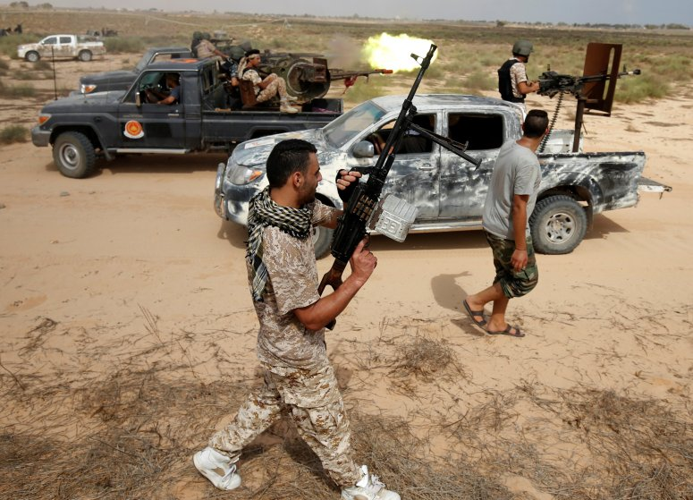 Libyan forces allied with the U.N.-backed unity government fire weapons as they move towards ISIS fighters' positions in Sirt, Libya, on July 15, 2016.