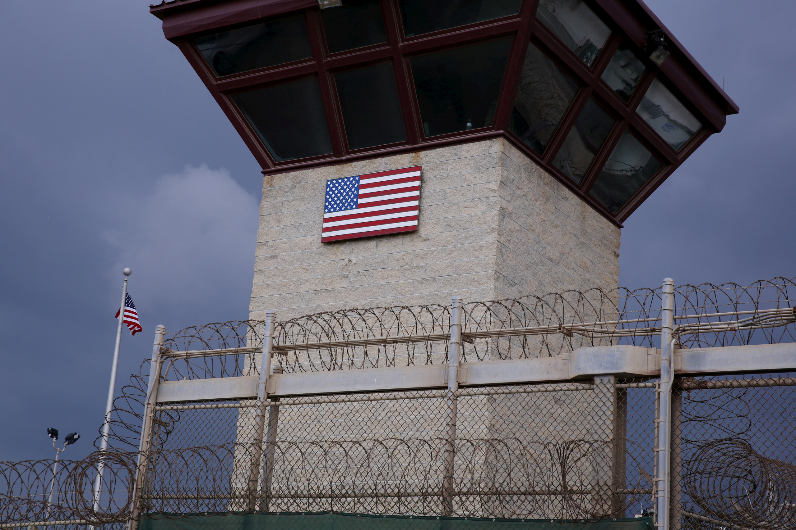 The United States flag decorates the side of a guard tower inside of Joint Task Force Guantanamo Camp VI at the U.S. Naval Base in Guantanamo Bay, Cuba, on March 22, 2016.