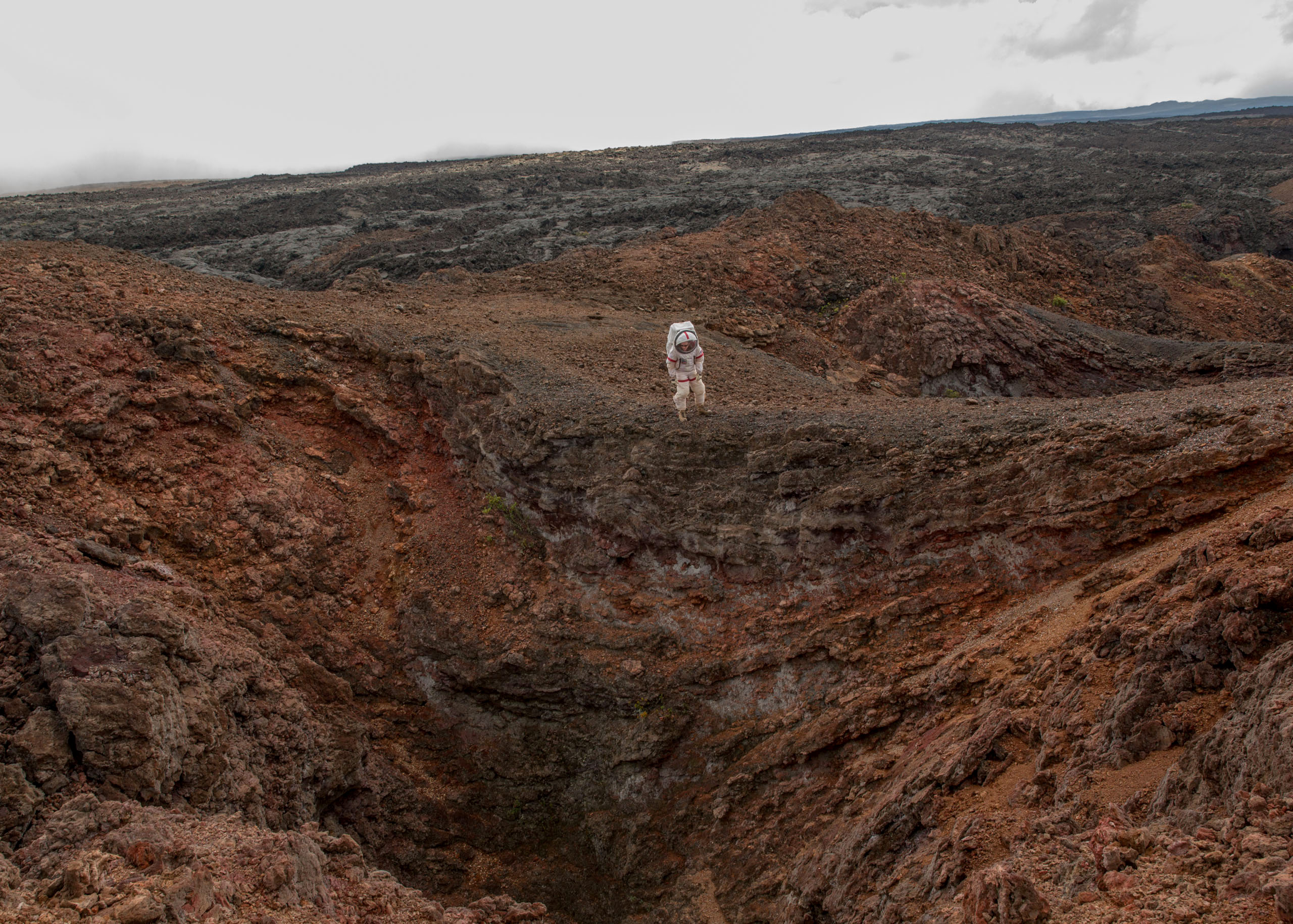 Carmel Johnston, Crew Commander for Mission 4, reenacts a spacewalk in a lava field near the HI-SEAS habitat on the island of Hawaii on Aug. 29, 2016. The crew emerged from 365 days in isolation on Aug. 28.
