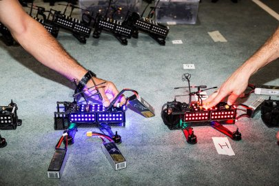 The LED lights on two racing drones are tested at the Drone Racing League offices on July 28, 2016 in New York.
