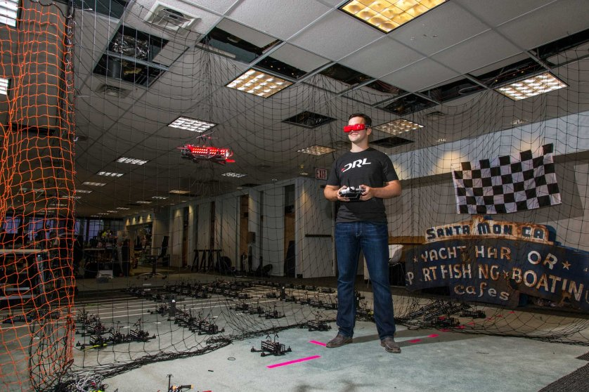 Drone Racing League CEO Nicholas Horbaczerski flys a drone in the DRL offices.