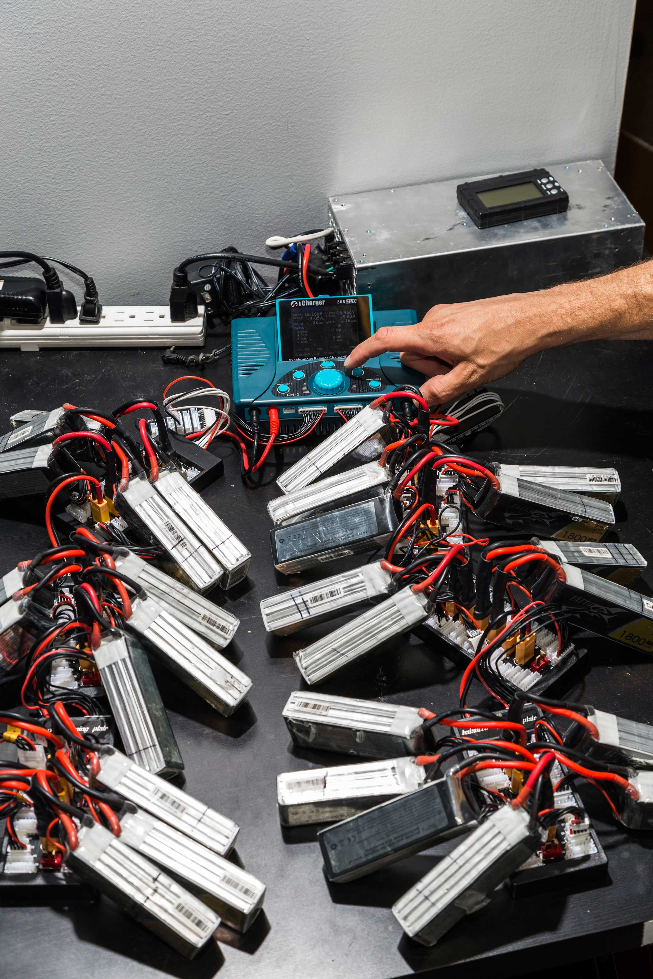 Drone batteries seen charging here. Drones have a tendency to rapidly burn through batteries.