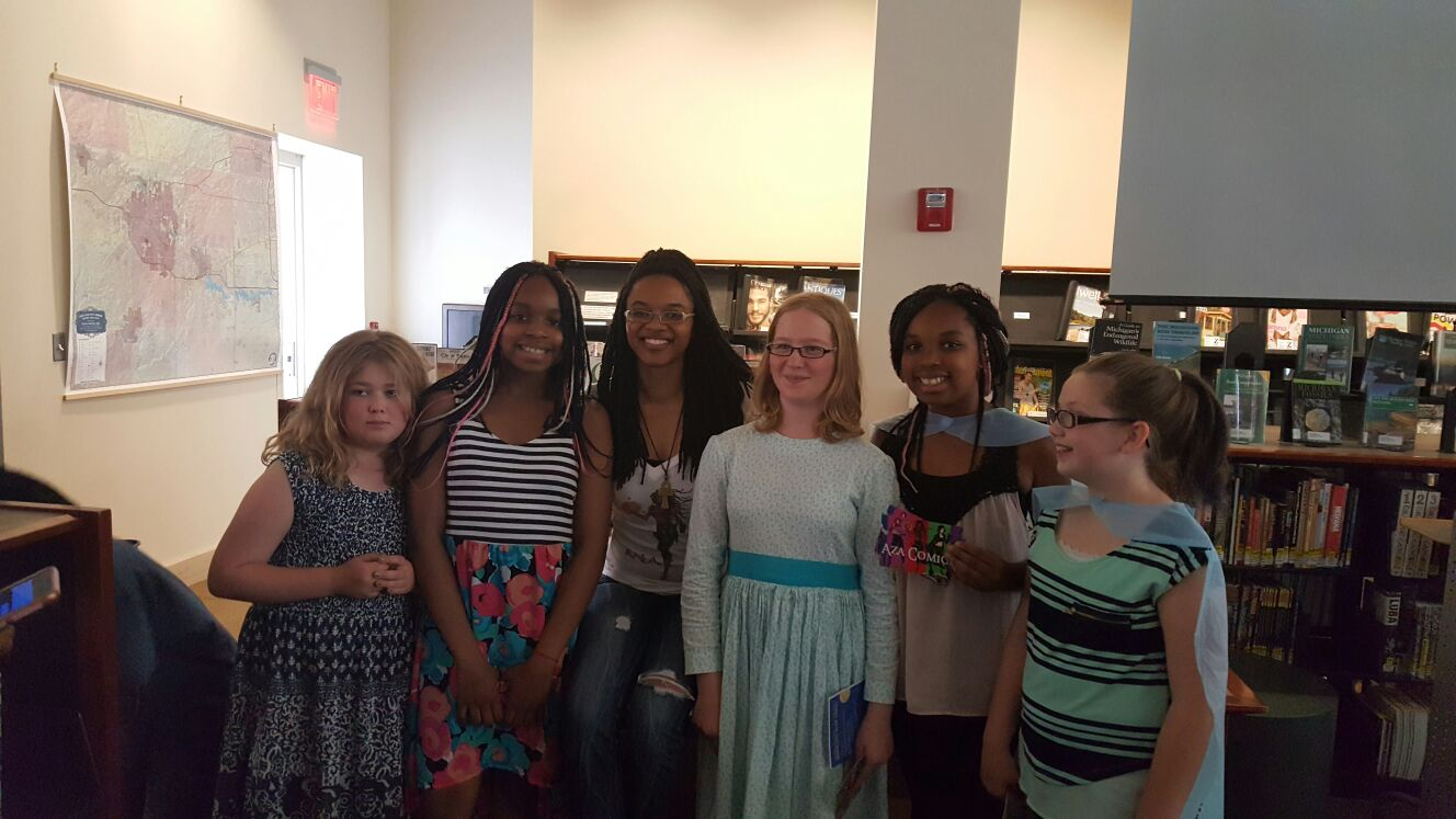 Jazmin Truesdale, founder of Aza Entertainment, poses with girls at the June 2016 Ann Arbor Book Festival.