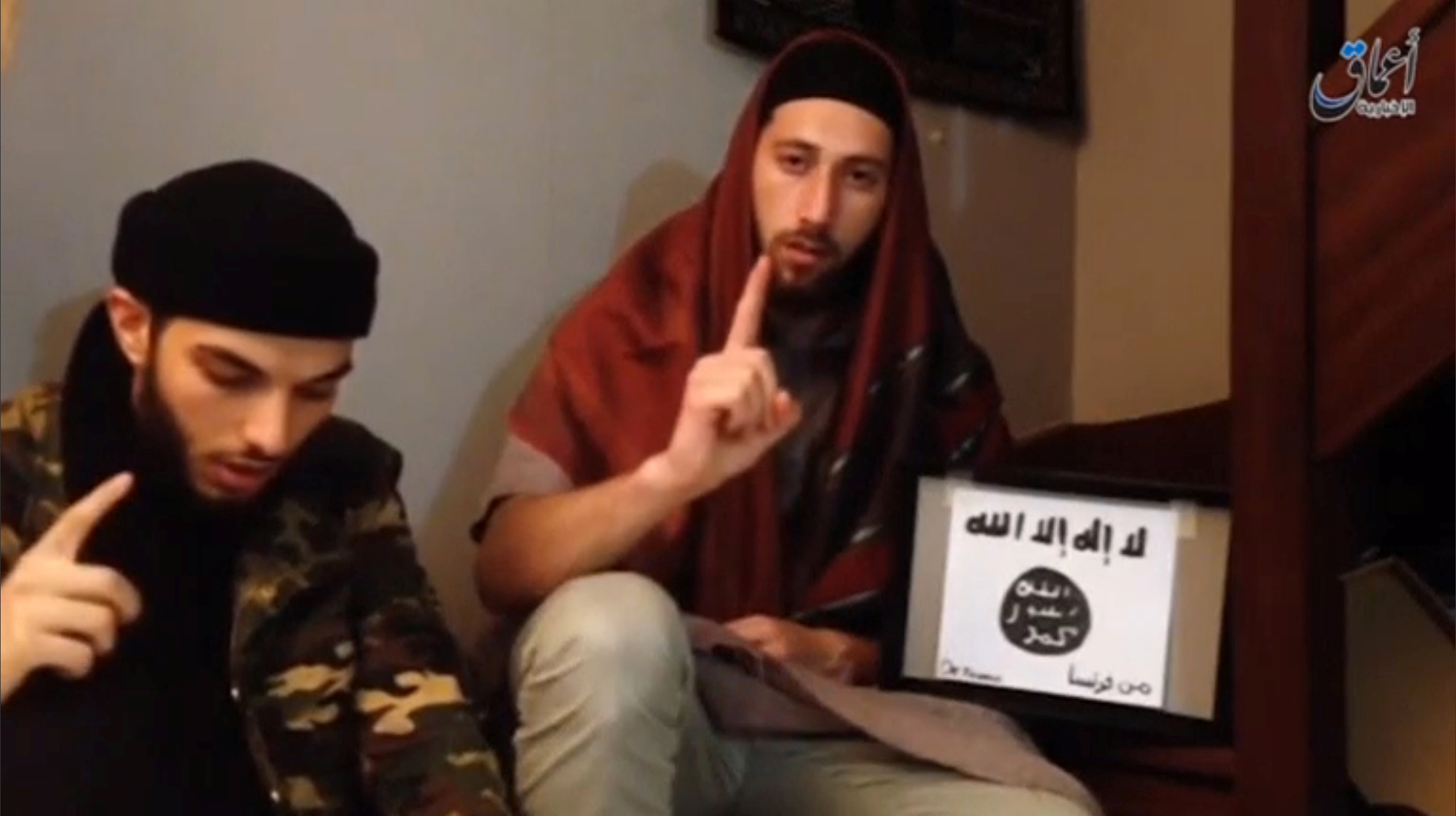 A still image taken on July 28, 2016 from an undated video posted on social media shows two men that the Islamic State said were the attackers of a church in France seated on the ground at an unknown location.