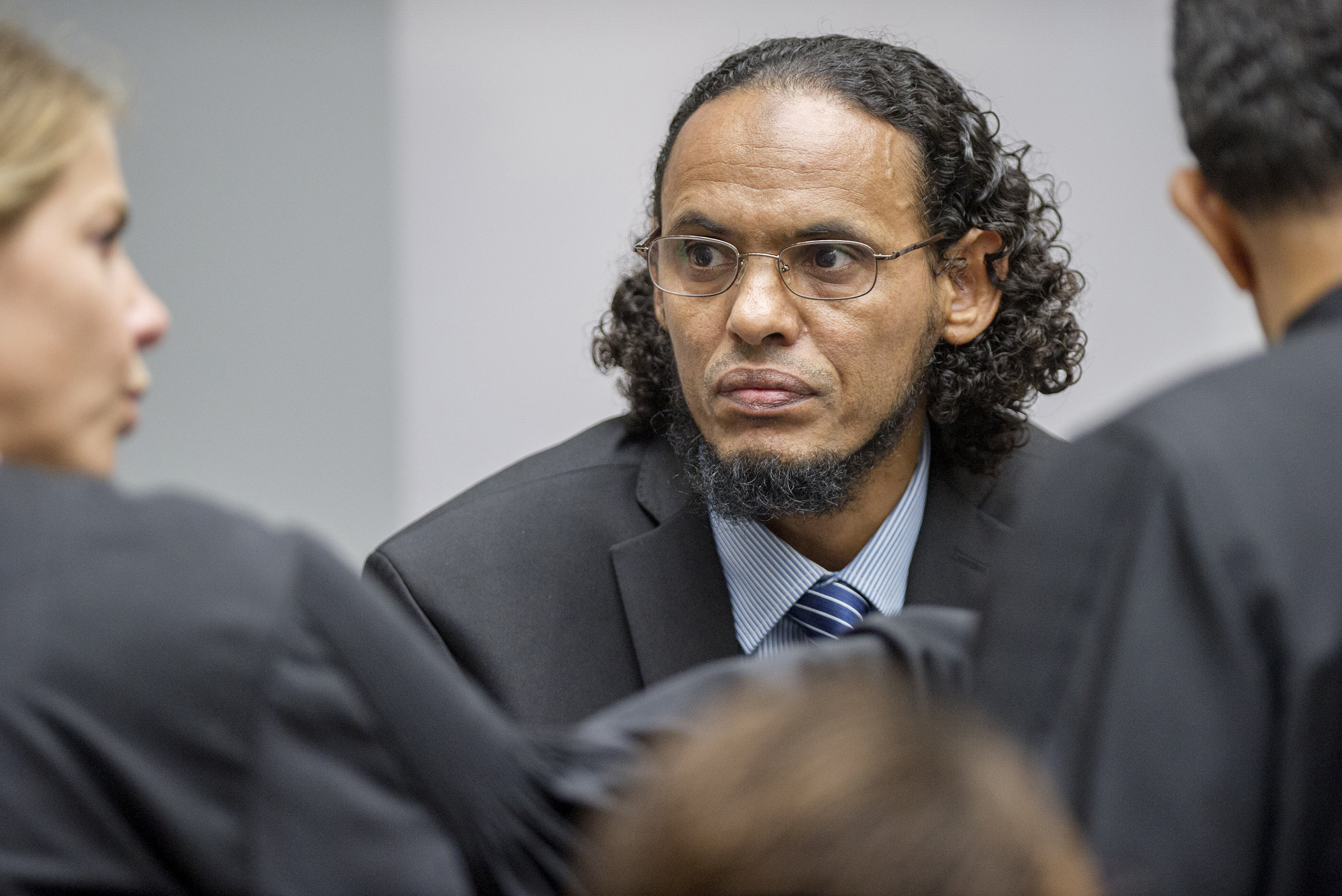 Ahmad Al Faqi Al Mahdi, center, appears at the International Criminal Court in The Hague, Netherlands, on Aug. 22, 2016, at the start of his trial on charges of involvement in the destruction of historic mausoleums in the Malian desert city of Timbuktu.