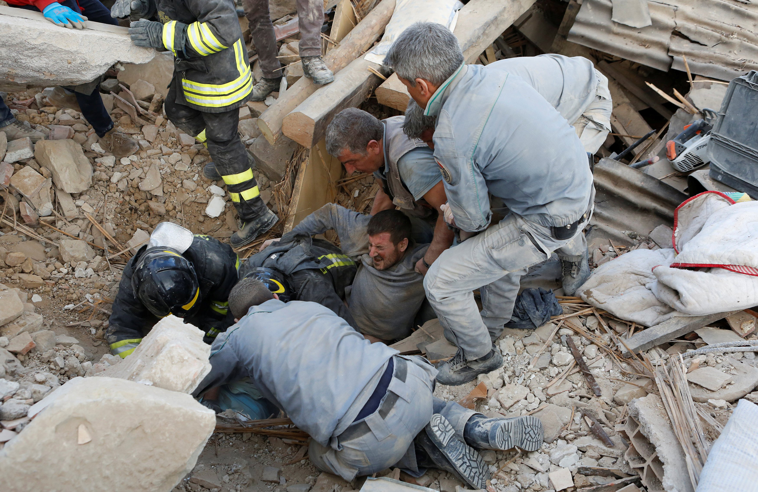 A man is rescued alive from the ruins following an earthquake in Amatrice, central Italy, Aug. 24, 2016.