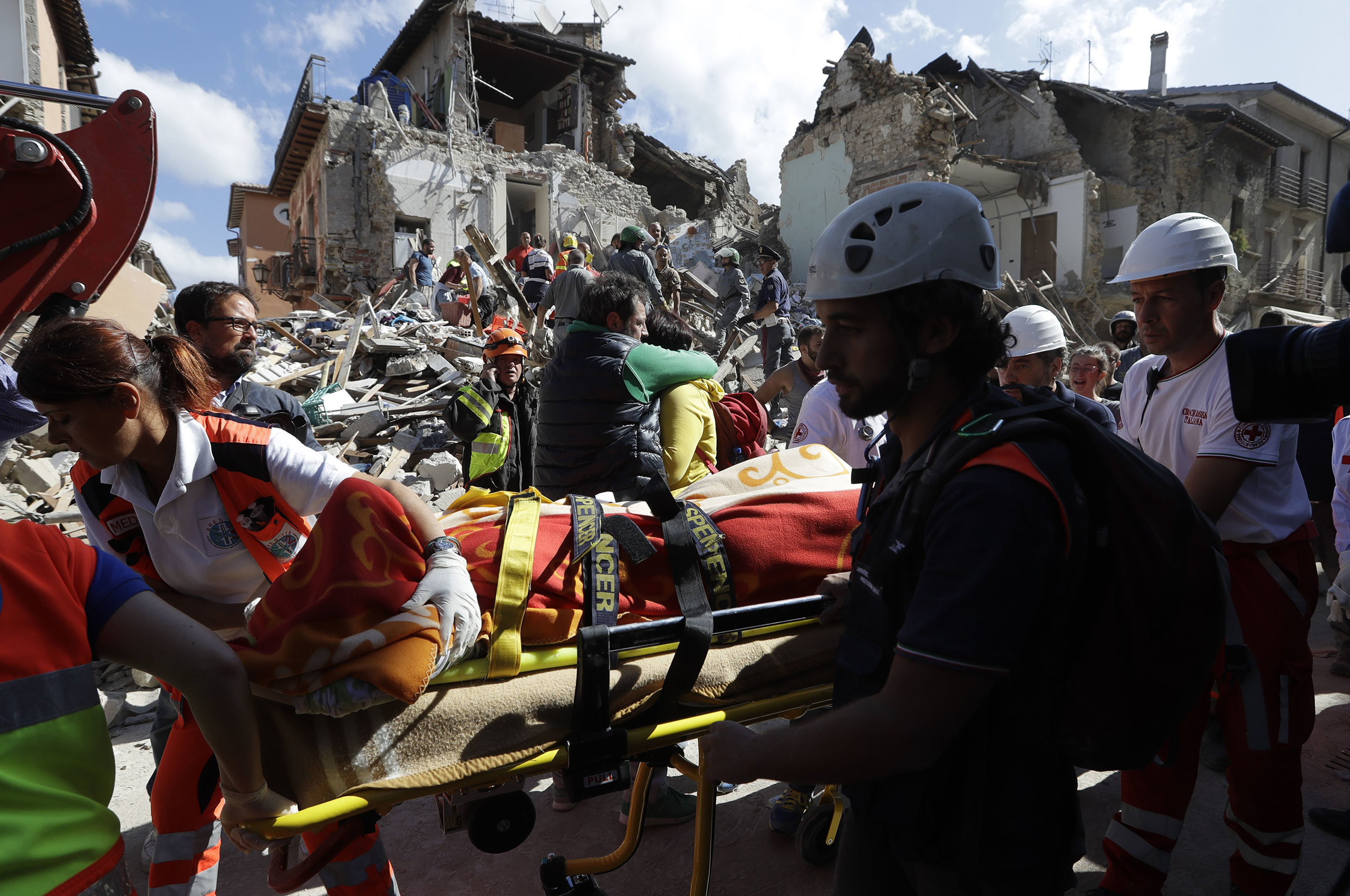 A victim is pulled out of the rubble following an earthquake in Amatrice Italy, Aug. 24, 2016.