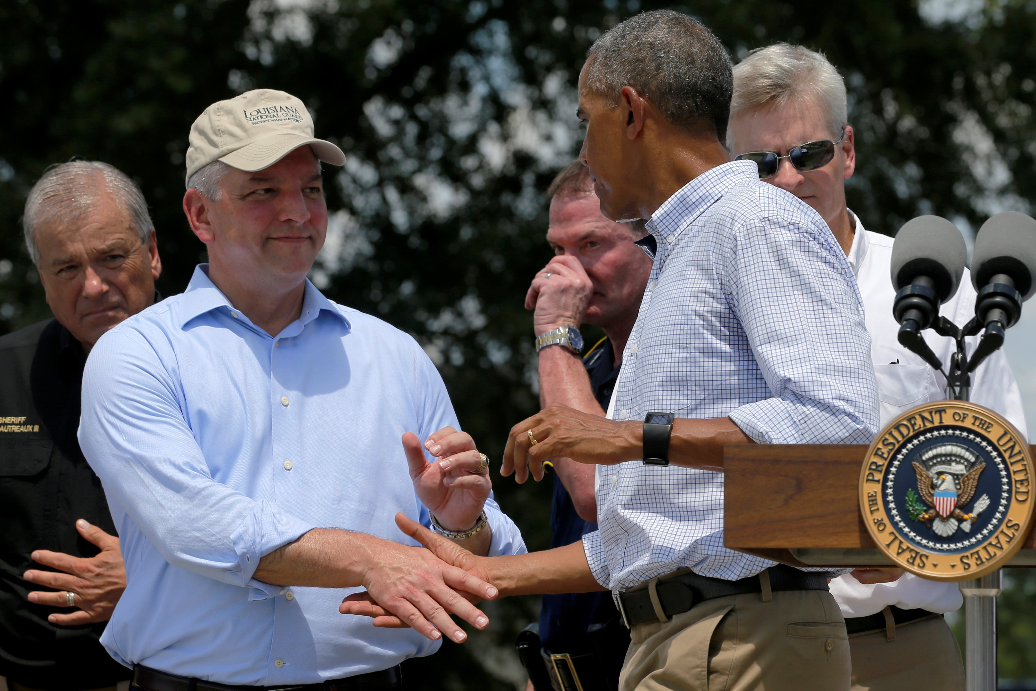 John Bel Edwards shakes hands with President Obama after his remarks following a tour of a flood-affected neighborhood in Zachary, Louisiana, on Aug. 23, 2016.