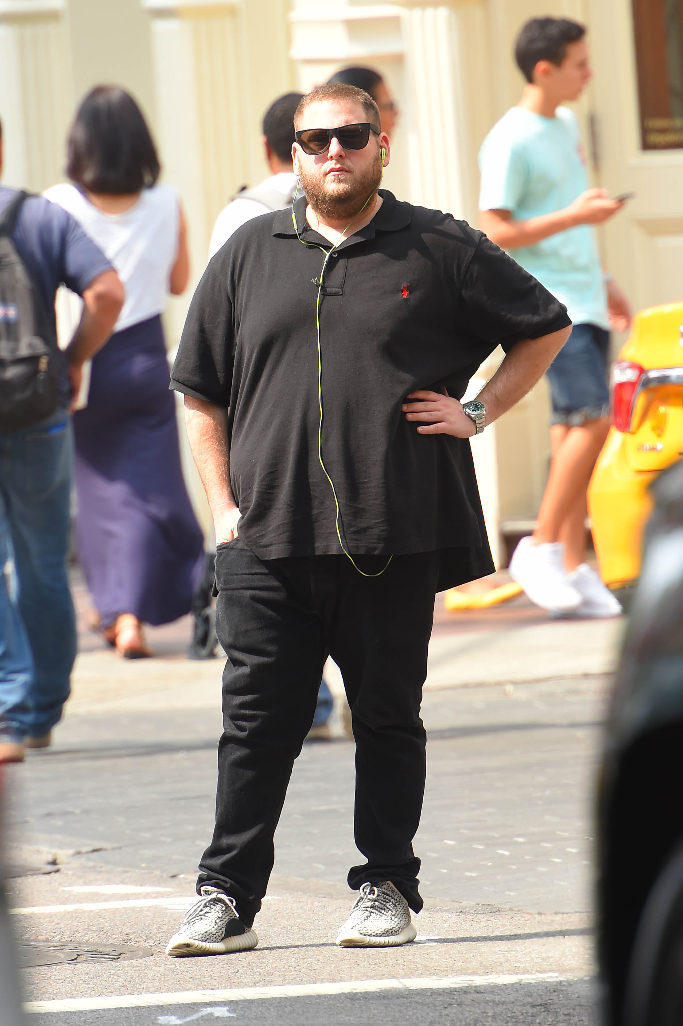 Out and about in Manhattan, Hill doesn't seem too pleased by the summer heat.