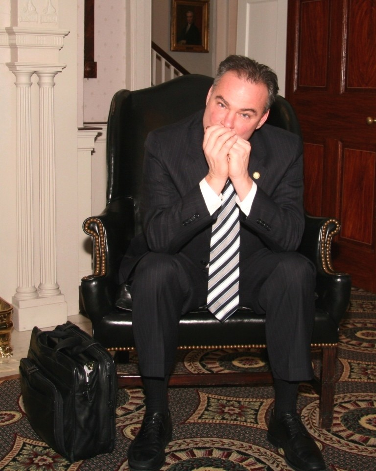 Tim Kaine playing one of his harmonicas