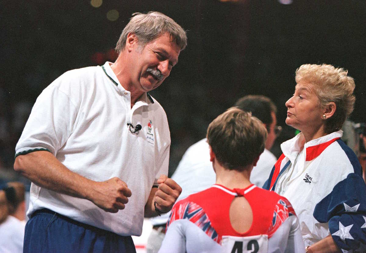 Coach Bela Karolyi (L) and wife Martha Karolyi show their delight with the performance of their protege Kerri Strug in the US Gymnastics Olympics Trials at the Fleet Center in Boston on June 30, 1996