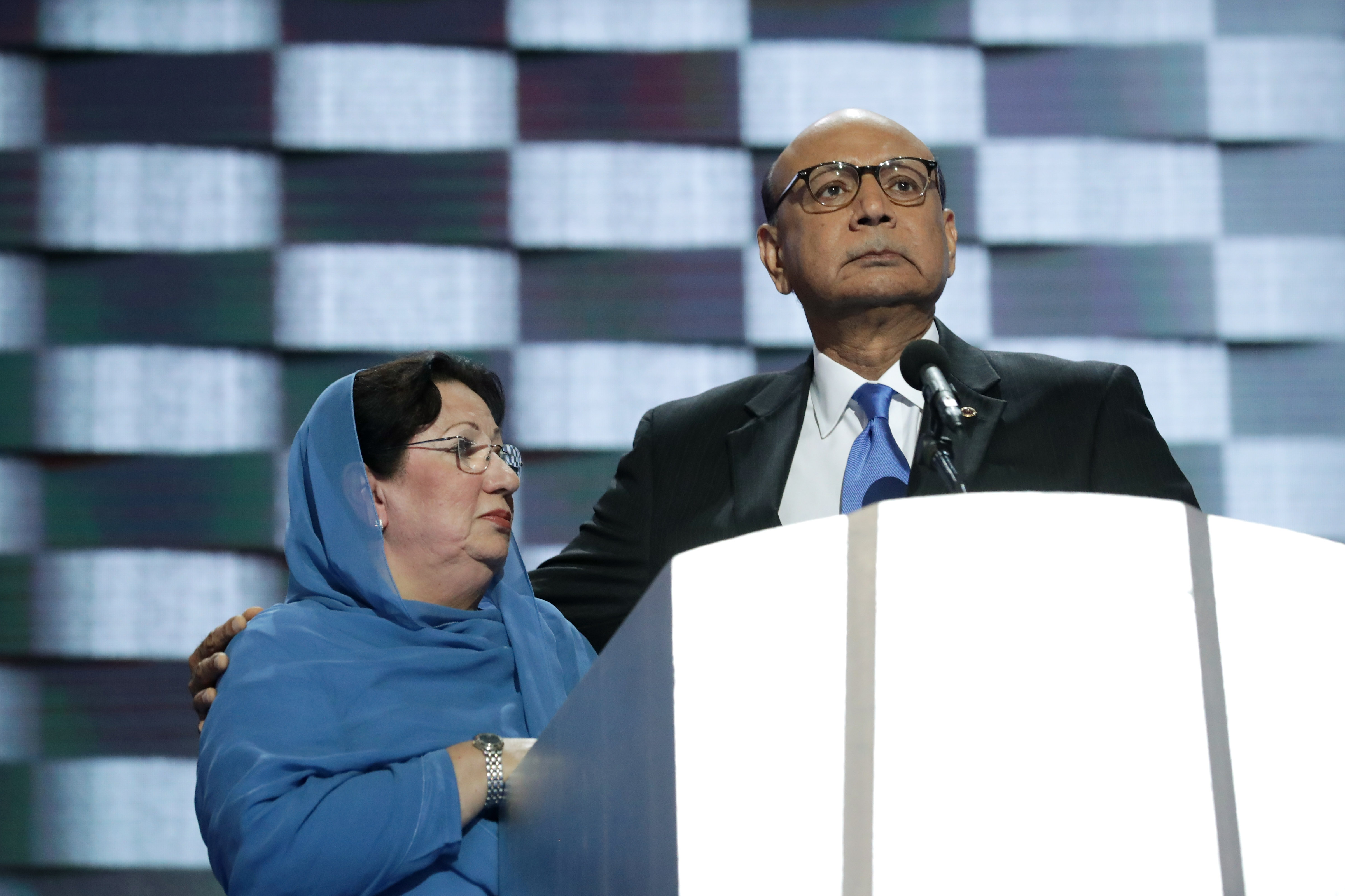 Khizr Khan, father of deceased U.S. Army Capt. Humayun Khan, delivers remarks as he is joined by his wife Ghazala Khan at the Democratic National Convention on July 28, 2016.