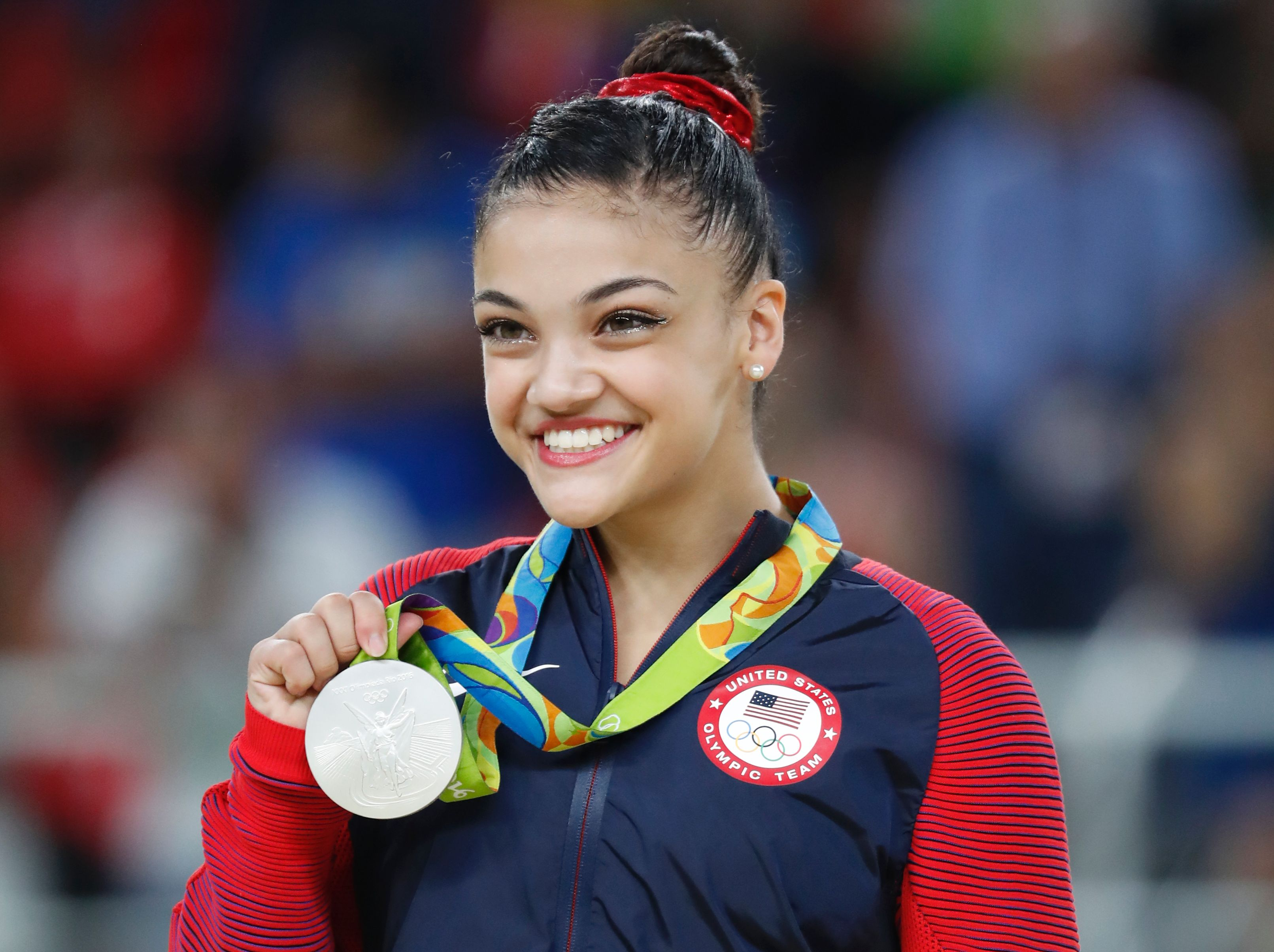 Silver medallist US gymnast Lauren Hernandez celebrates on the podium of the women's balance beam event final of the Artistic Gymnastics at the Olympic Arena during the Rio 2016 Olympic Games in Rio de Janeiro on August 15, 2016.