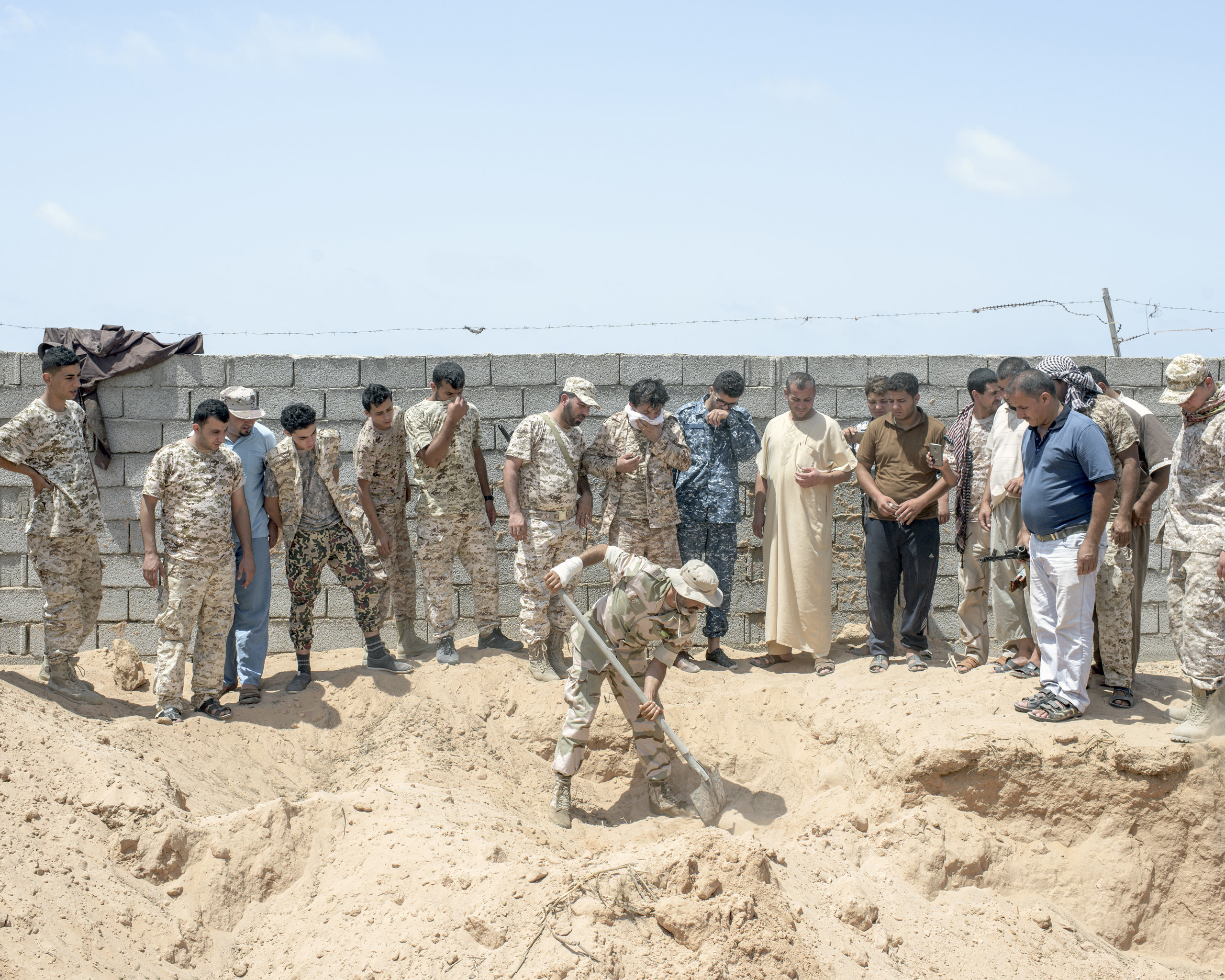 Libyan fighters unearth an ISIS mass grave, Sirt, Libya, July 2016