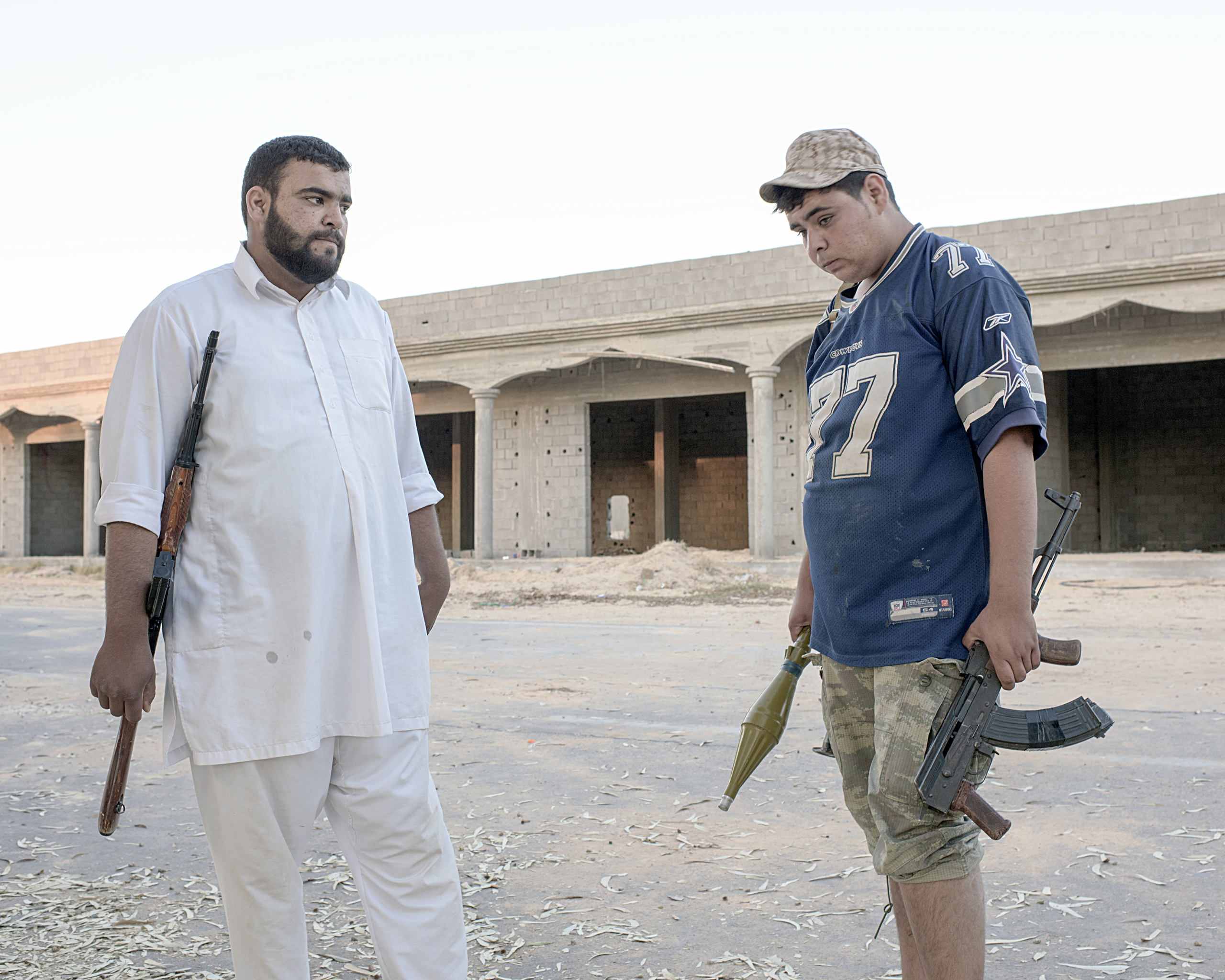 Two Libyan civilian volunteers who are fighting on the frontline against ISIS, Sirt, Libya, July 2016.