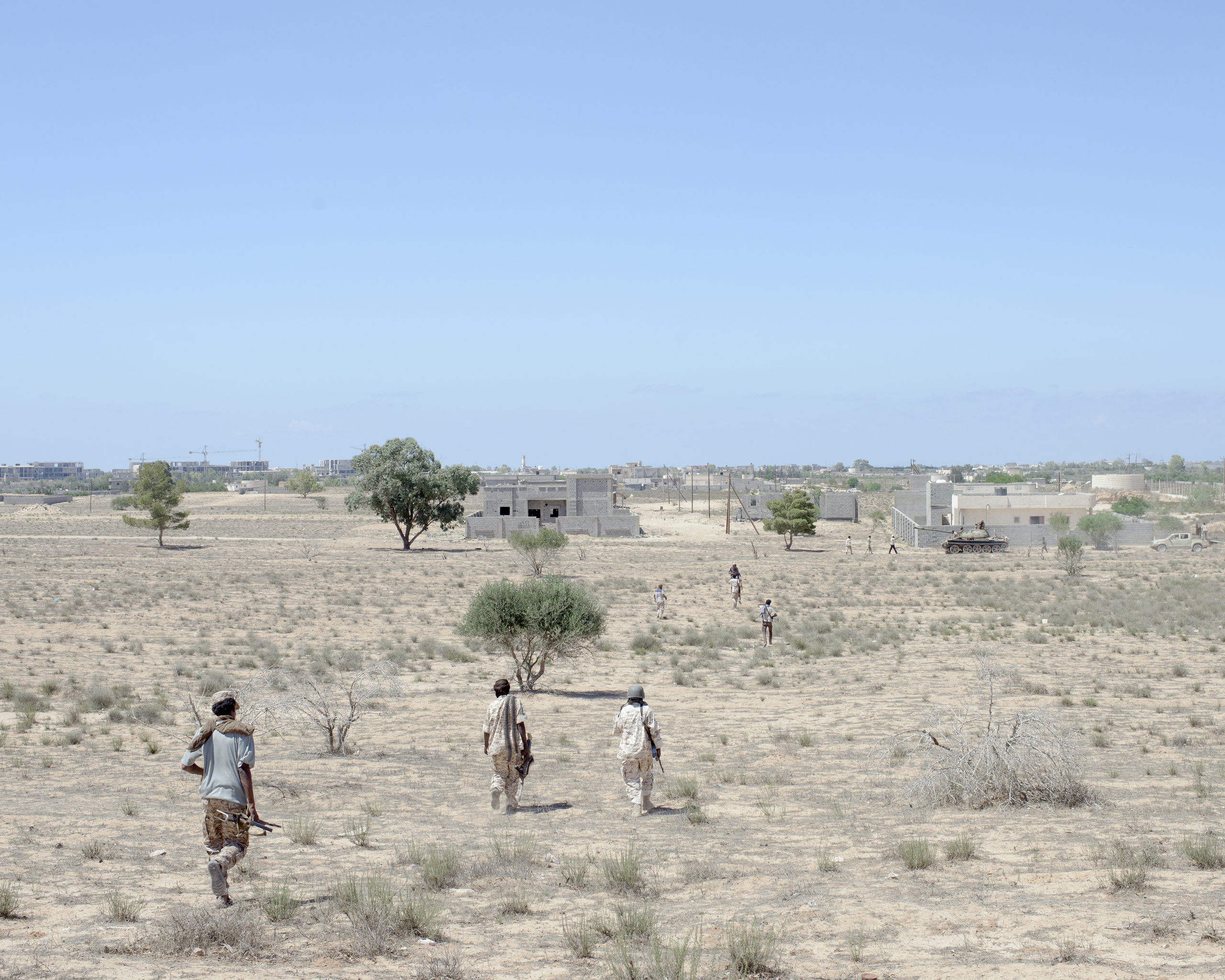 Libyan fighters advance through a minefield in the Abu Hadi district, Sirt, Libya, July 2016.