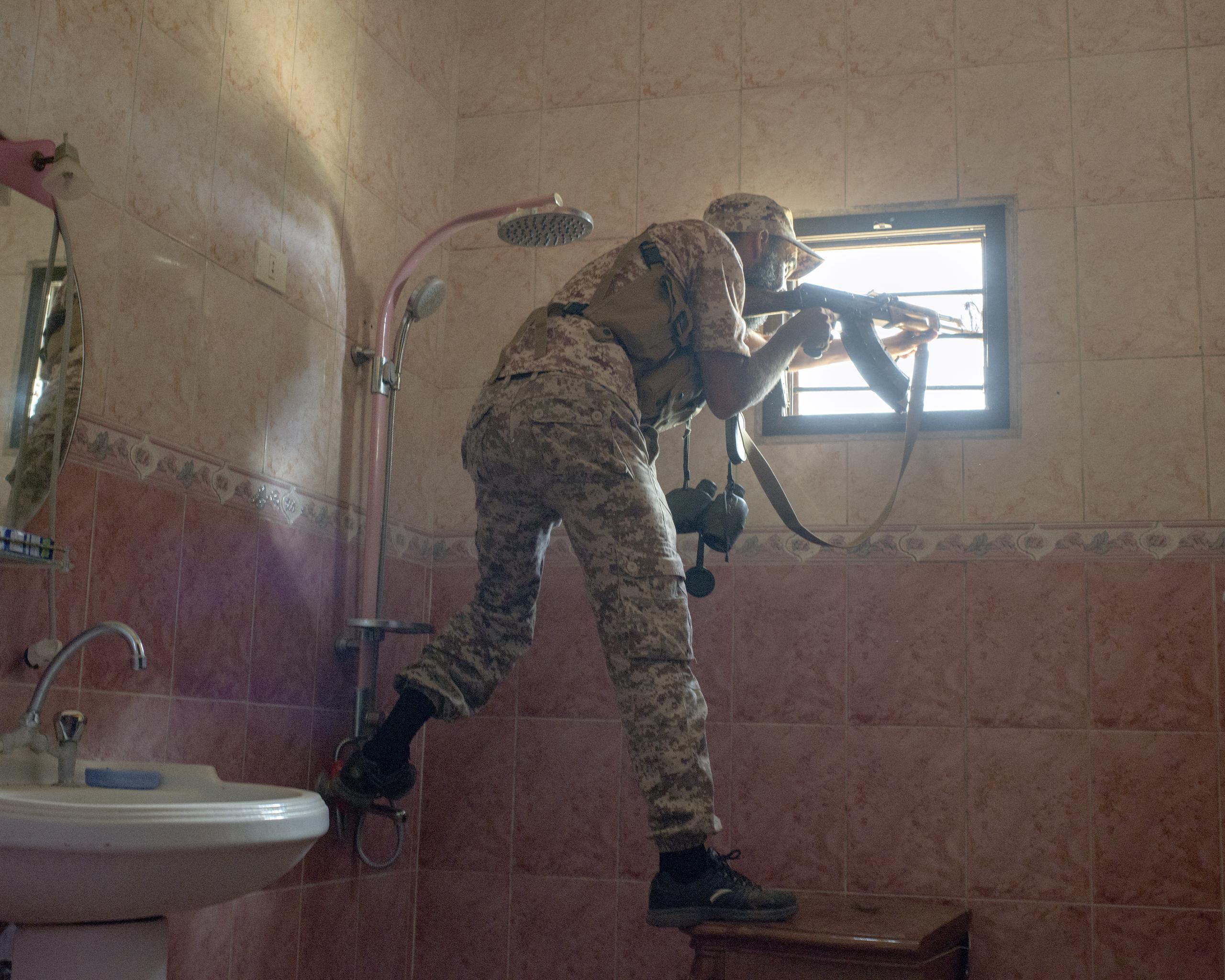 A Libyan sniper in Sirt's Hay Dollar district, Libya, July 2016.