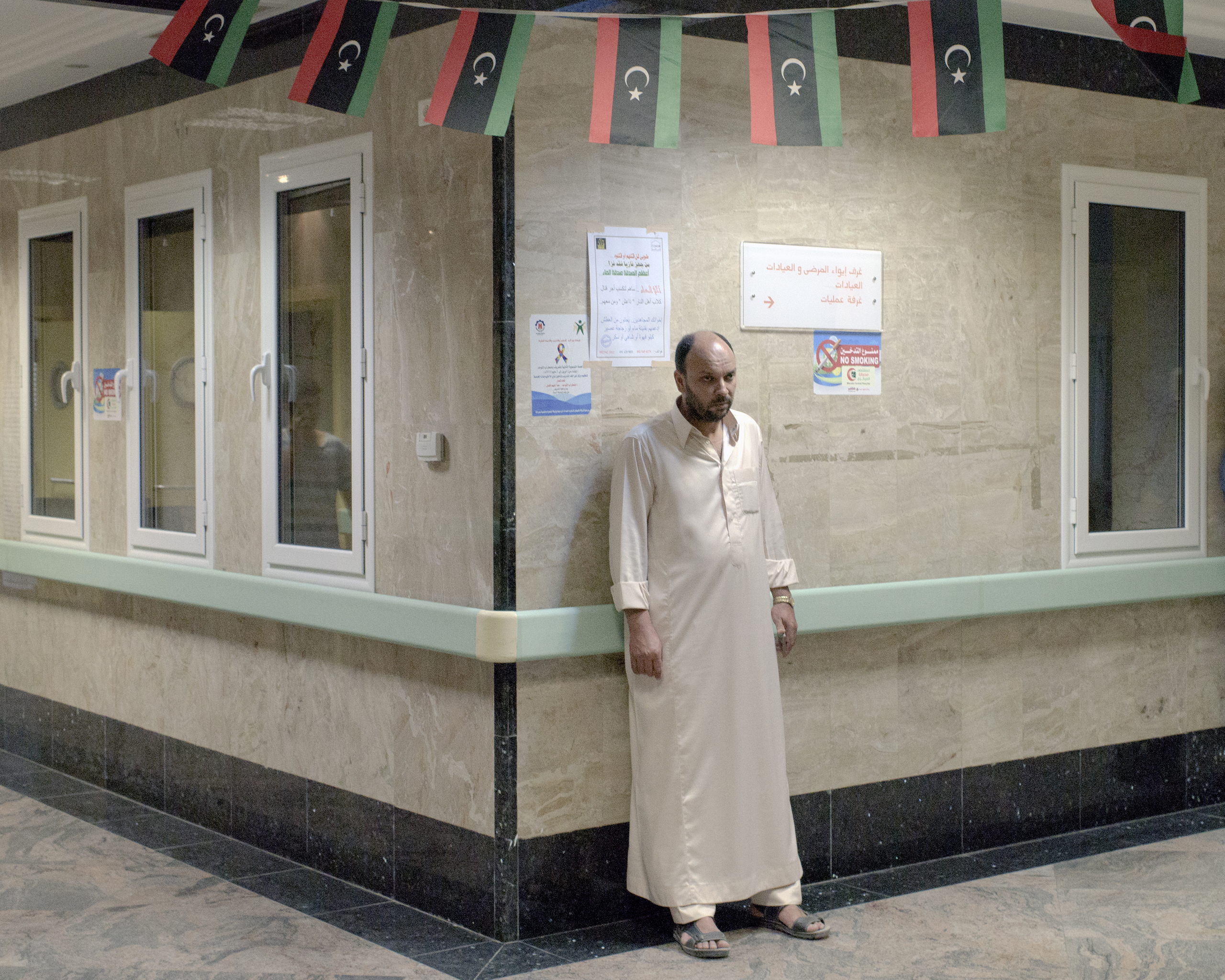 A relative of a wounded fighter waits outside the emergency room of Misratah Central Hospital Misratah, Libya, July 2016.