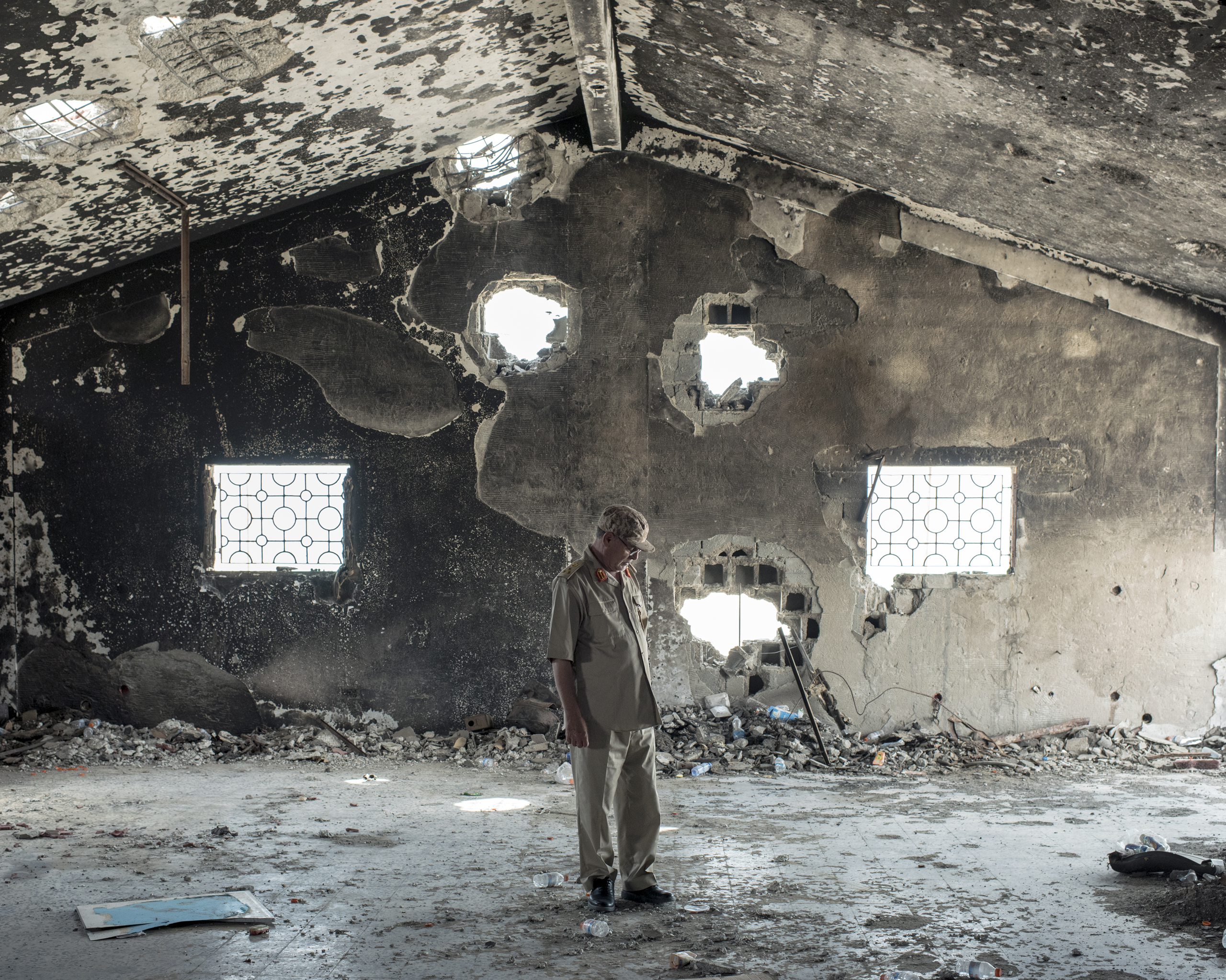 General-Brigadier Mohamed Al-Ghossri surveys the damage from the aftermath of an ISIS suicide bomb on a field hospital, Sirt, Libya, July 2016.