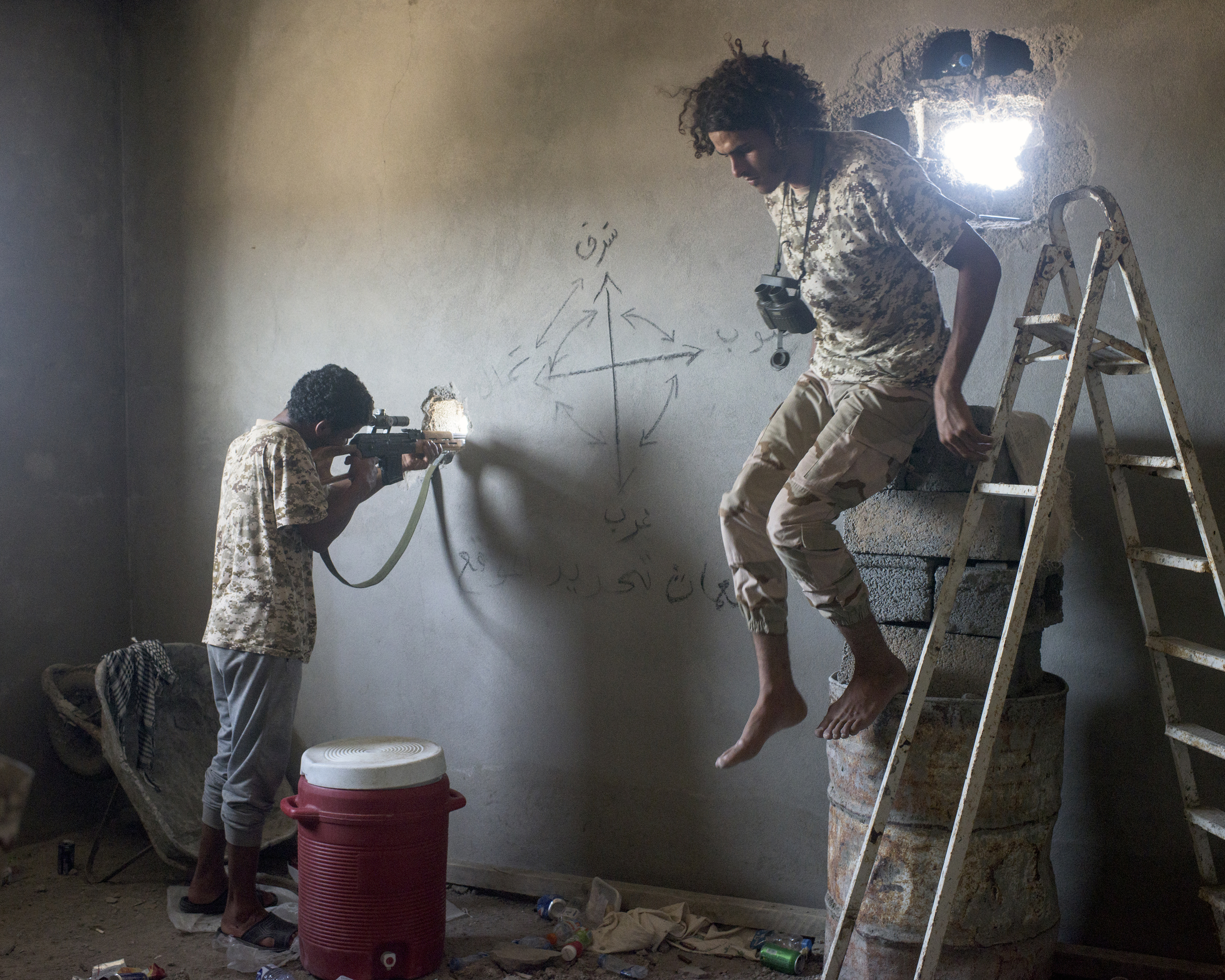 A Libyan sniper and his spotter in the Hay Dollar neighborhood, Sirt, Libya, July 2016.