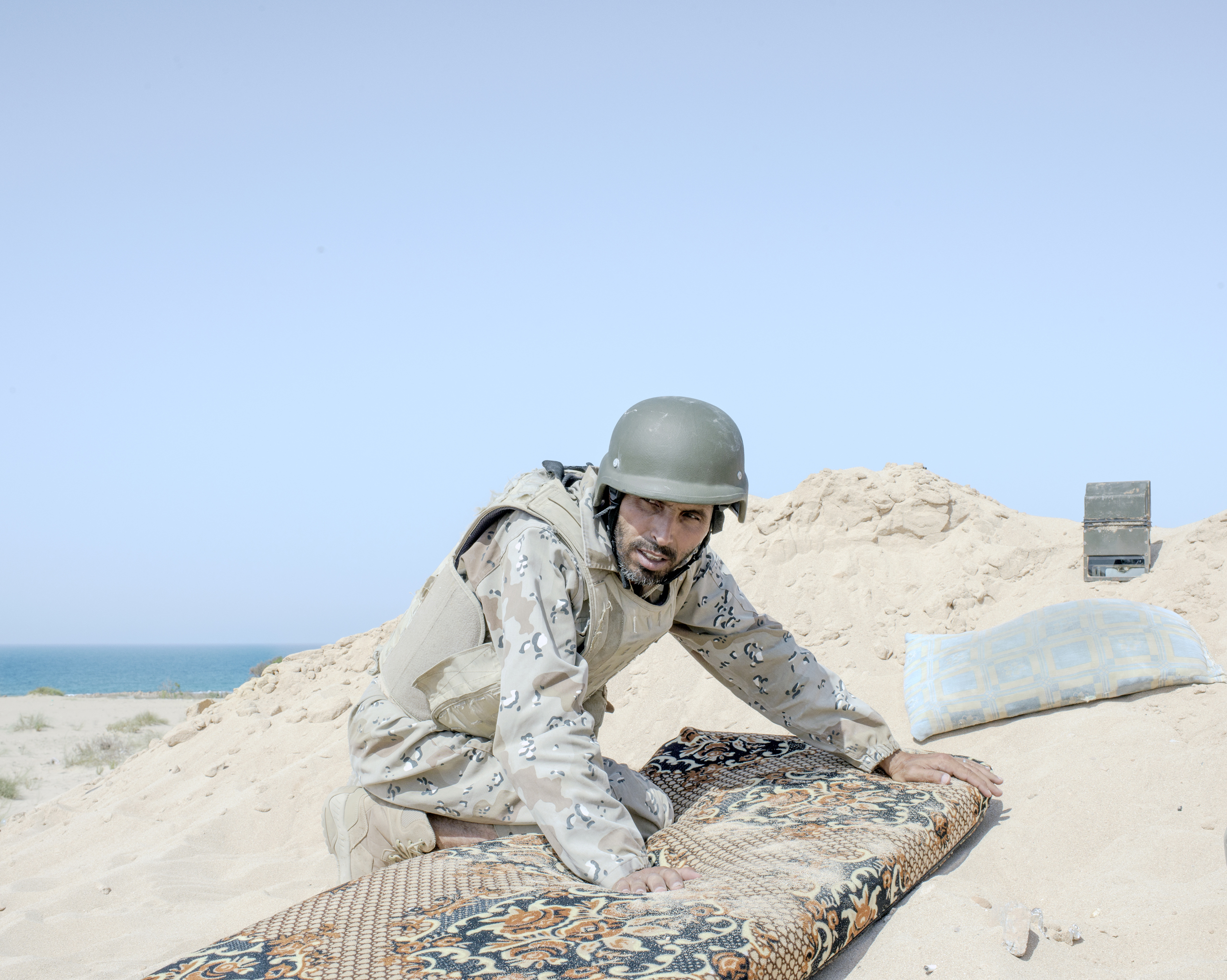 A Libyan spotter identifies ISIS positions on the westernmost frontline against ISIS on the Sirt seafront, July 2016.
