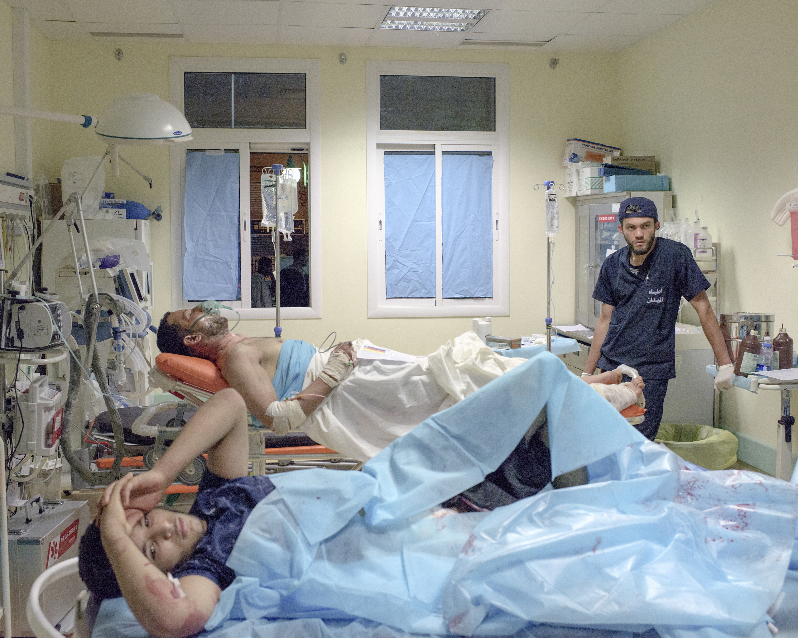 Two Libyan fighters who were wounded on the frontline against ISIS were taken to the emergency room of Misratah Central Hospital, Misratah, July 2016.