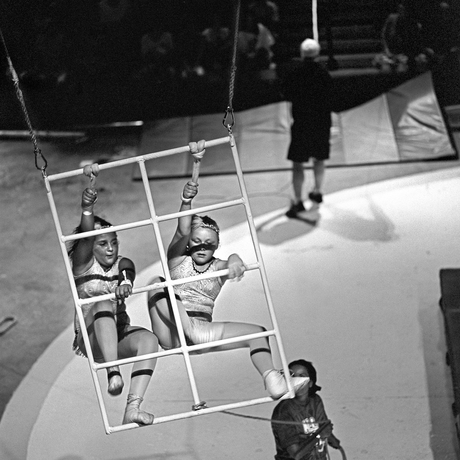 Swinging ladders is an act performed by 8-10 year olds. Spotters control the speed of the swing and keep close watch over the young performers.