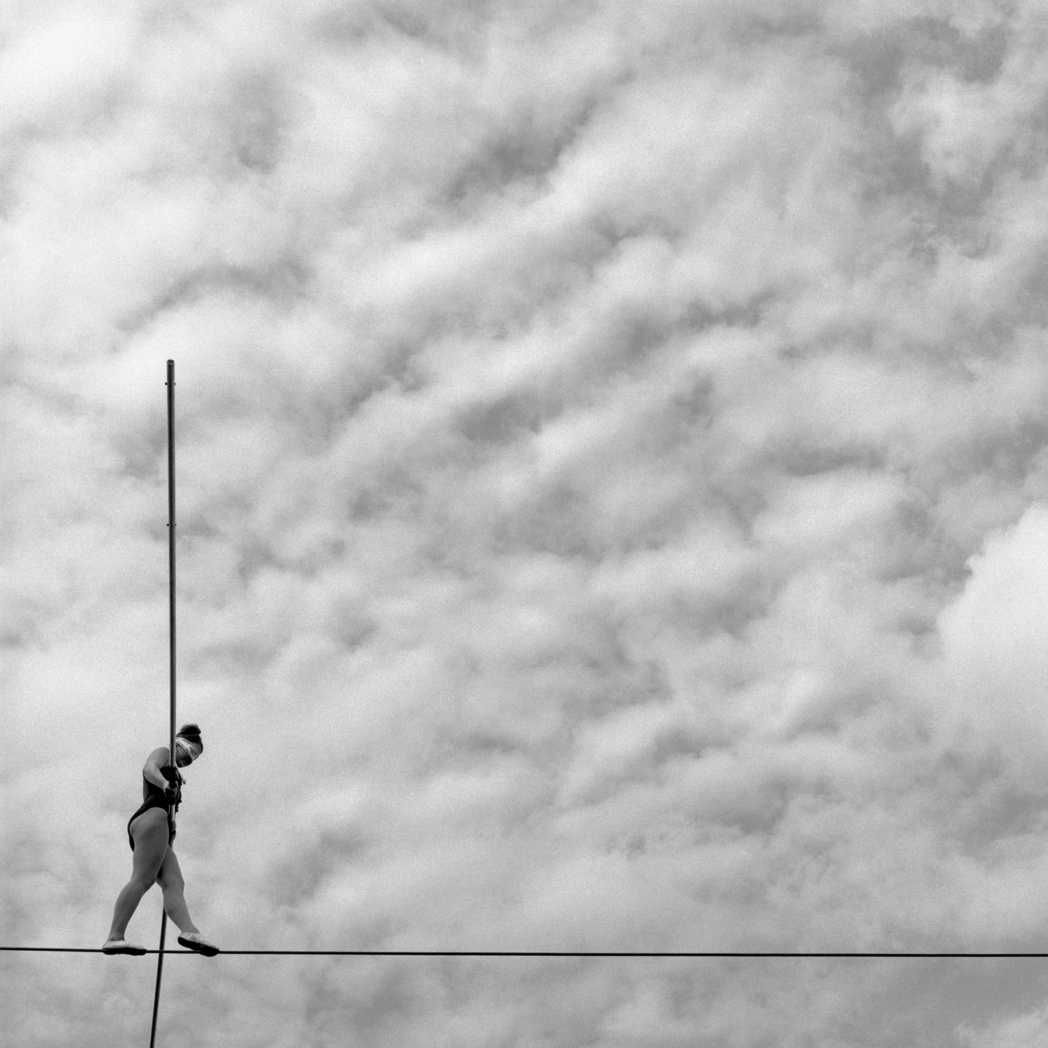 Tarrin Cooper moves across the high wire, blindfolded, at a road show in Reynolds, Indiana. She is the great granddaughter of Clyde Beatty, a lion tamer who made his home in Peru decades earlier.
