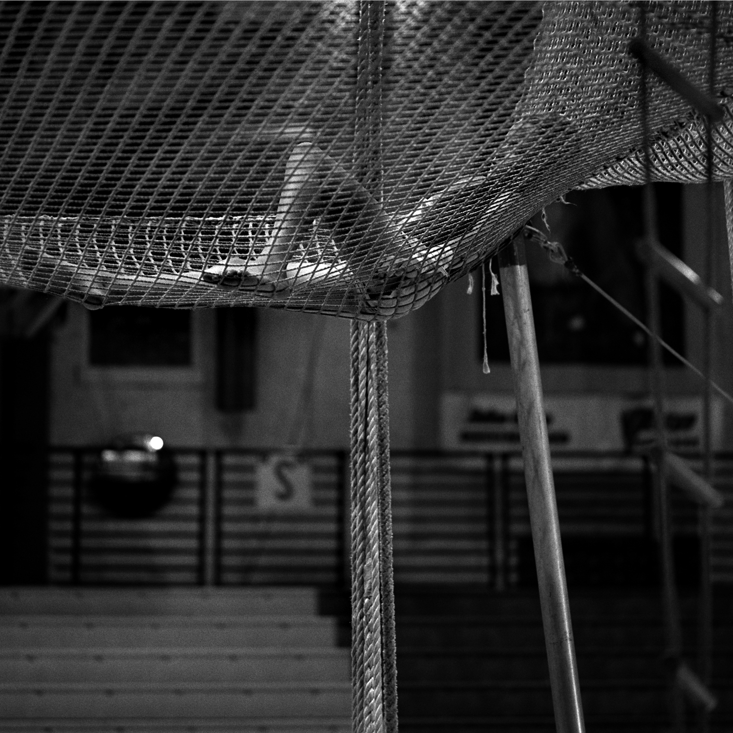 Josie Murphy, 13, rests between practice sessions. Josie is a third generation flying trapeze performer, one of a number of families whose participation spans generations. The following year she could no longer perform because basketball presented a scheduling conflict.