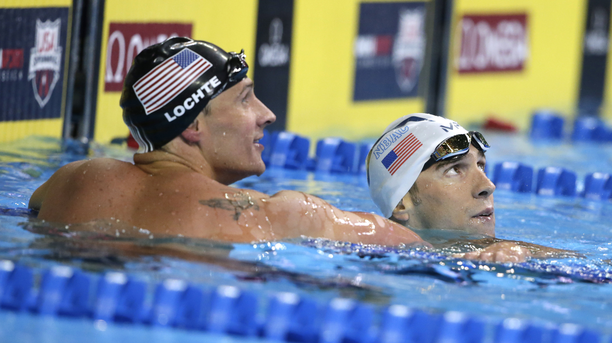 Michael Phelps, right, reacts with Ryan Lochte, left, after winning the men's 200-meter individual medley final at the U.S. Olympic swimming trials, in Omaha, Neb. on July 1, 2016. Lochte finished in second place.